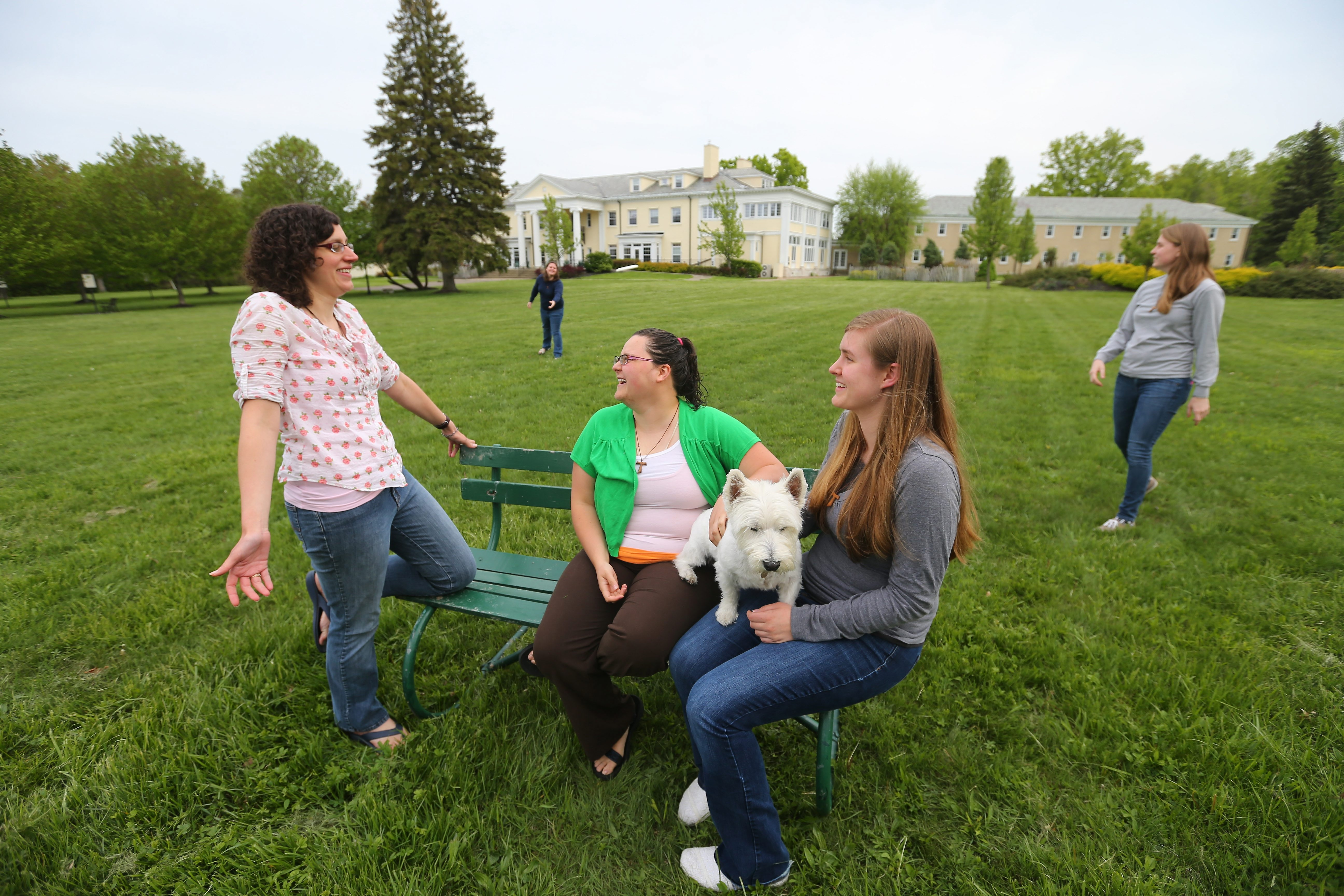 From left, Kristen Leaderstorf, Alycia Murtha, Nicolette Langlois, Catherine Chance and Lindsey Martin enjoy some down time at the St. Columban Center in Derby on May 21. (Mark Mulville/Buffalo News)