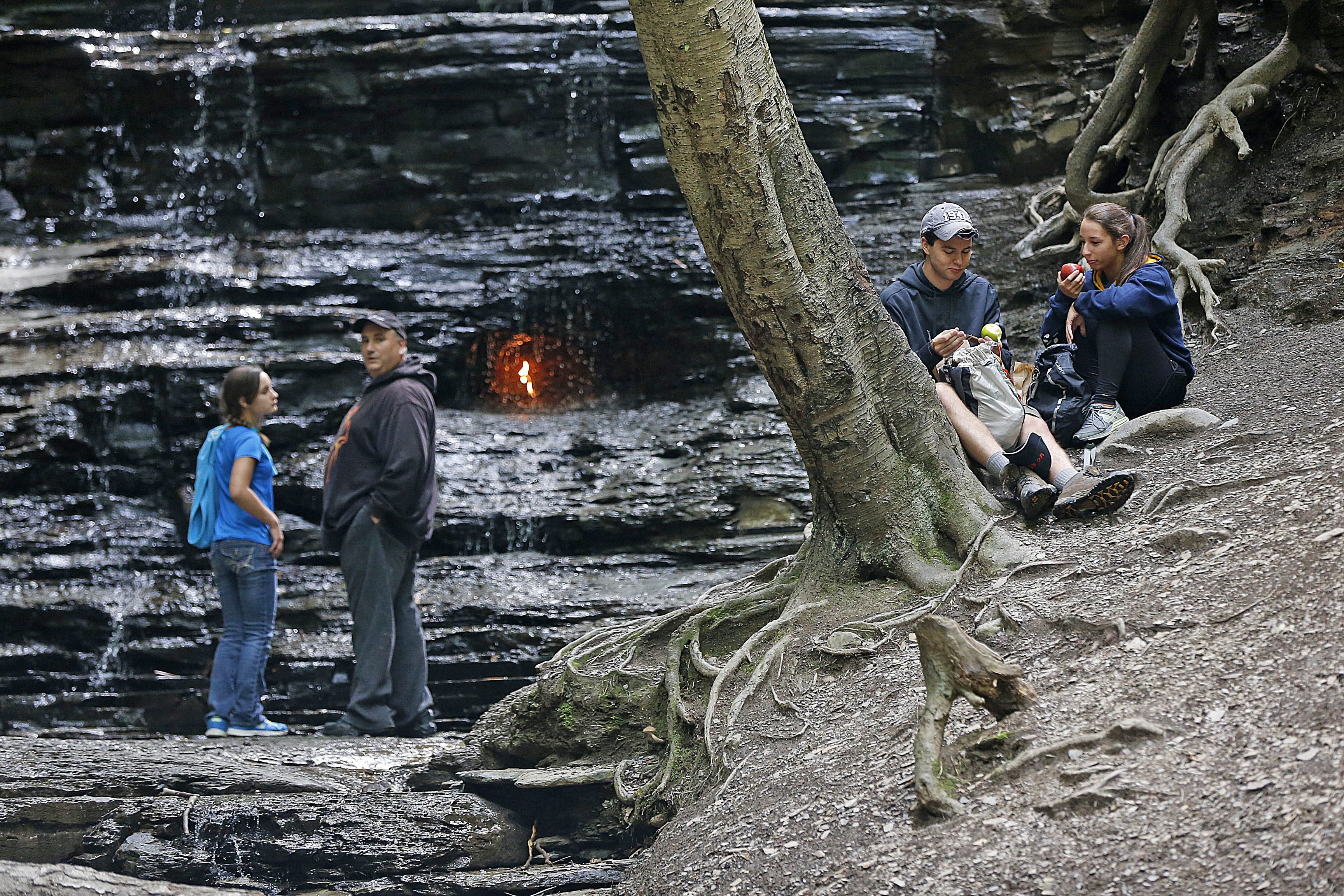 A couple stops for a picnic lunch near the Eternal Flame at Chestnut Ridge Park in Orchard Park.