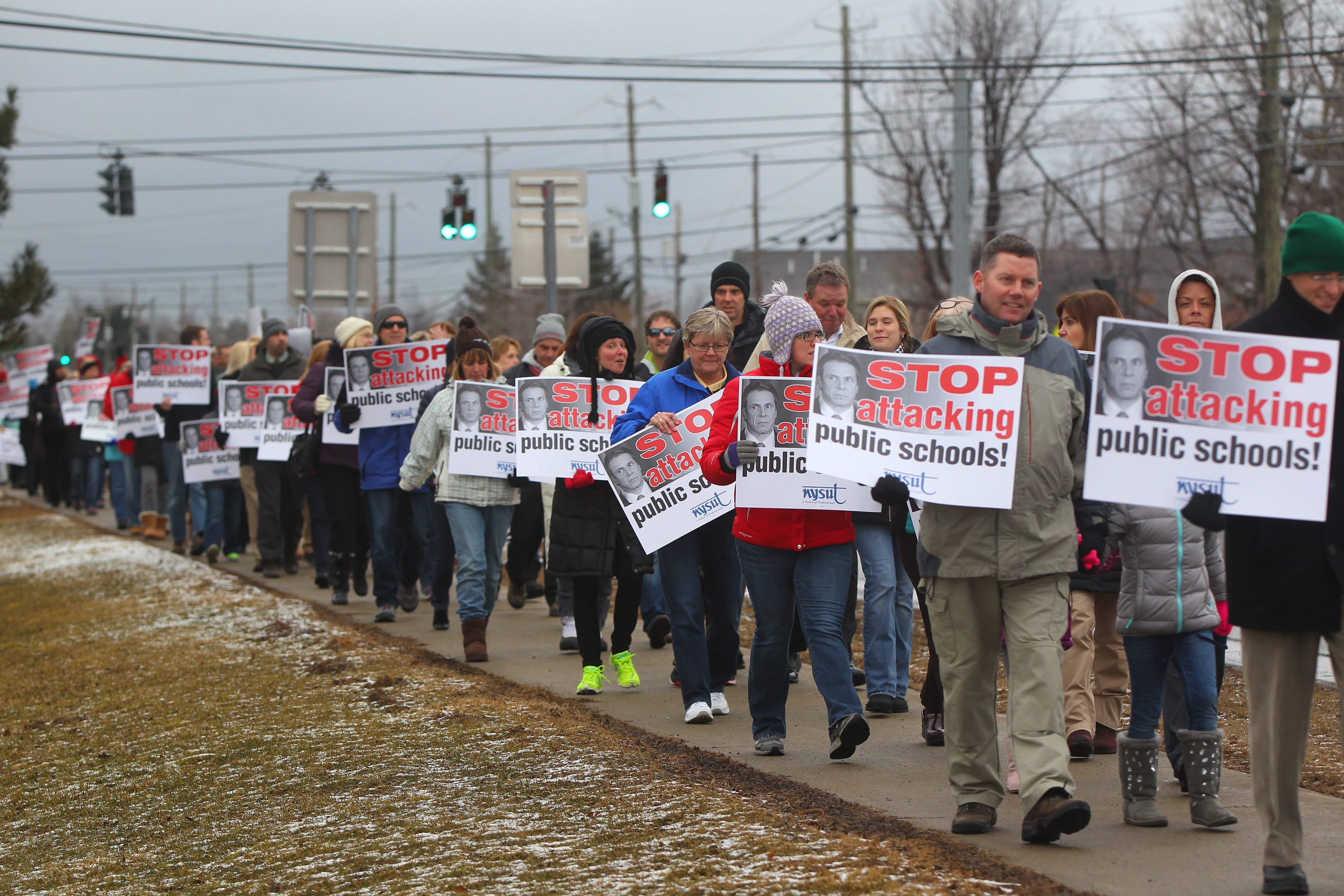 Teachers unions have consistently and vocally opposed Gov. Andrew M. Cuomo's efforts to institute an evaluation system. Here, Clarence teachers demonstrate at the high school March 30. (Mark Mulville/Buffalo News)