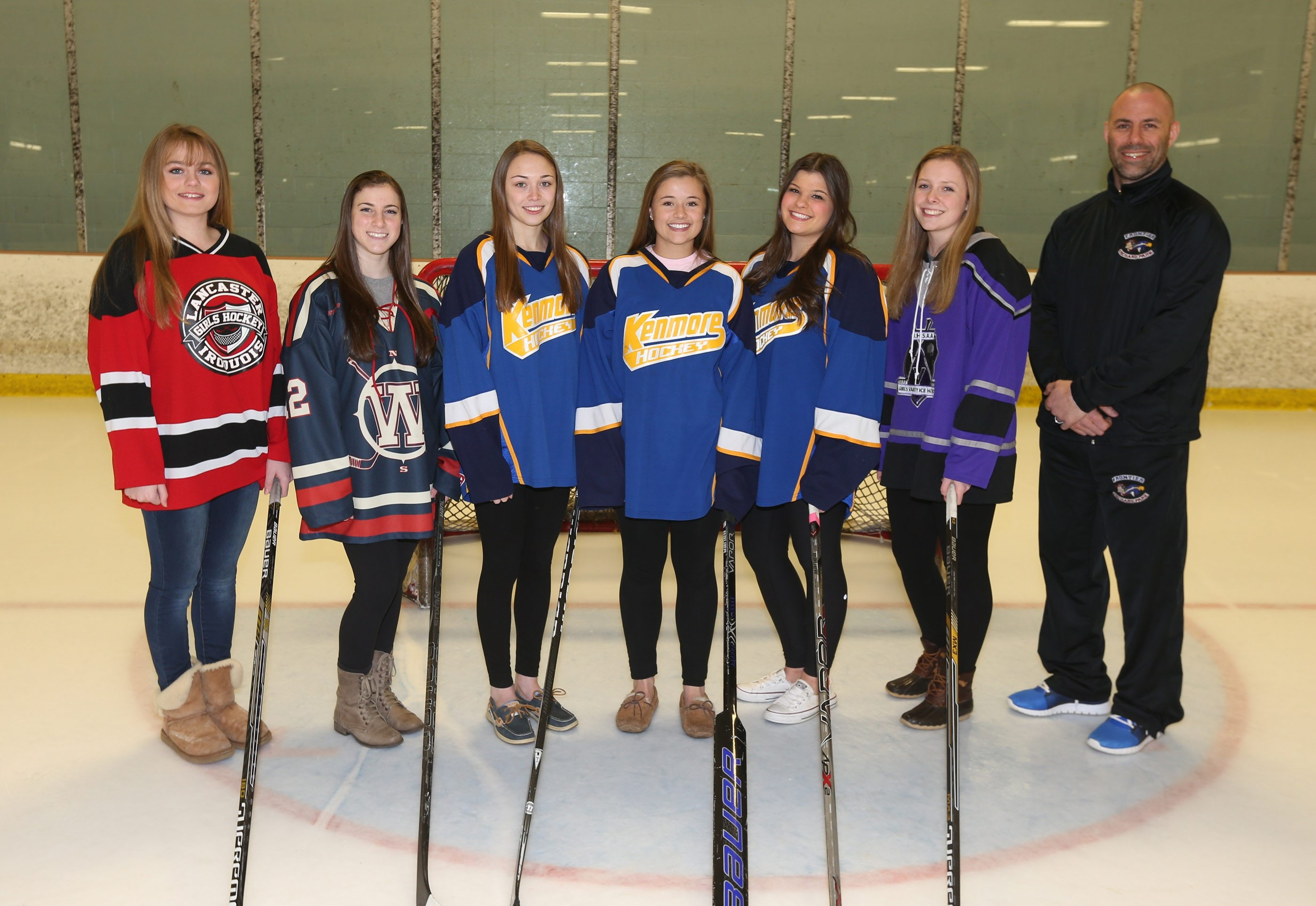 The girls All-Federation team, from left, are Megan Ruekauf, Lancaster/Iroquois;  Sarah Scolnick, Williamsville; Olivia Smith, Kenmore; Lauren Pray, Kenmore; Ana Orzechowski, Kenmore; Kaitlyn Drew- Mead, Monsignor Martin;  and Coach of the Year Jim McCarthy, Frontier-Orchard Park.