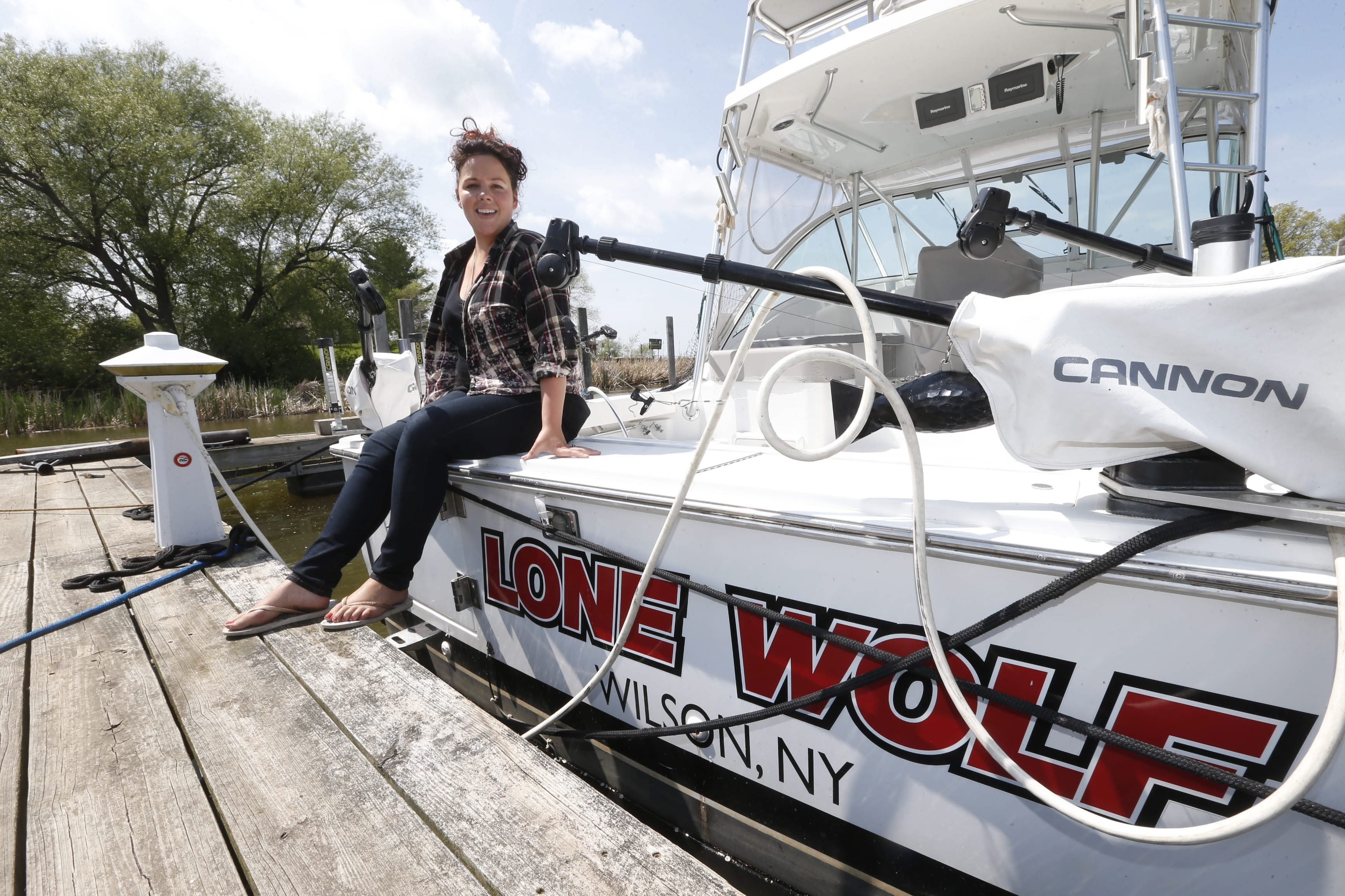Michelle Evans, who owns the Sunset Bar and Grill and Wilson Boat House with her husband, takes a break at the marina they also own on Monday.