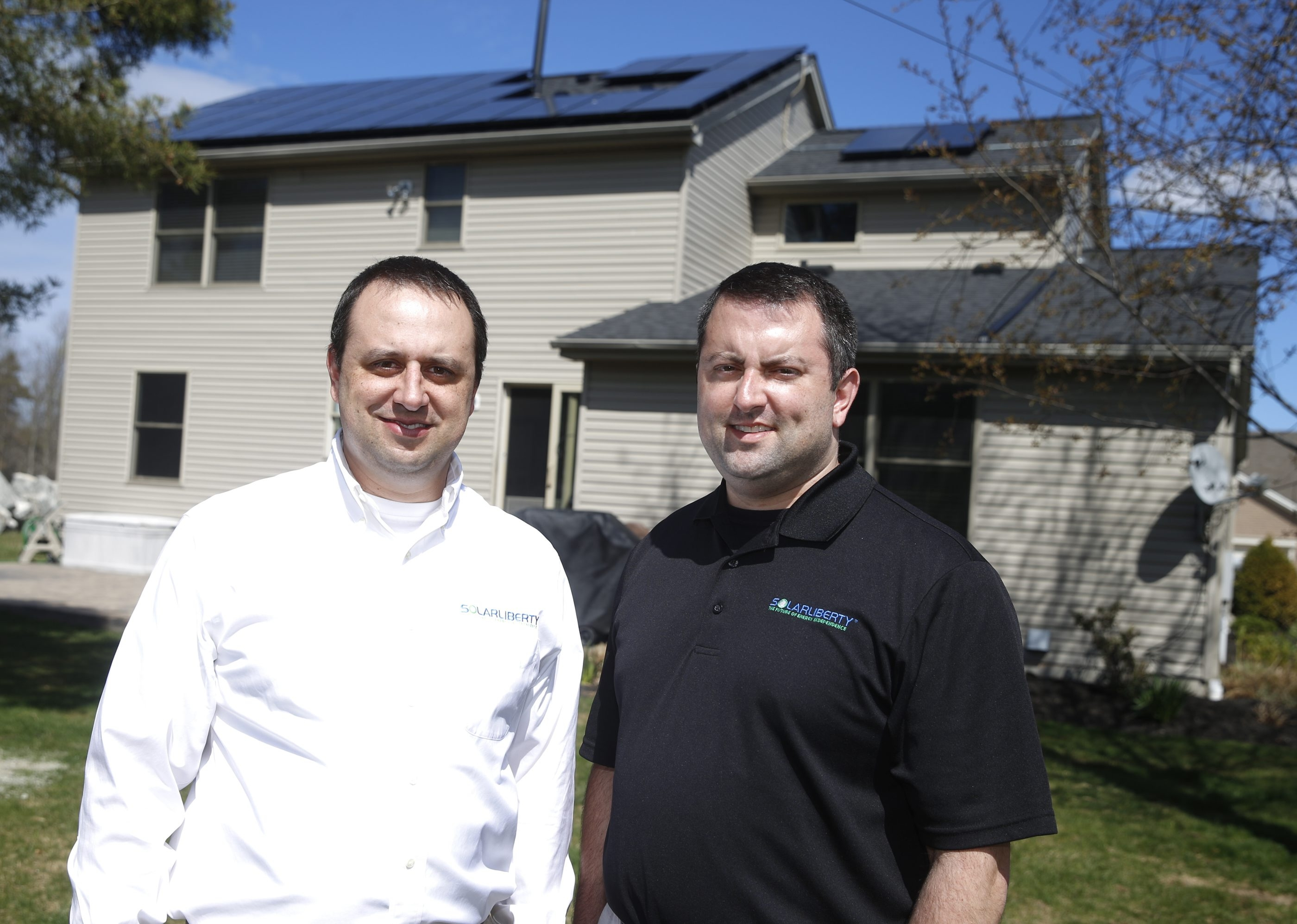 Adam Rizzo, president of Solar Liberty, left, and his brother Nate, vice president, learned as they grew Solar Liberty.