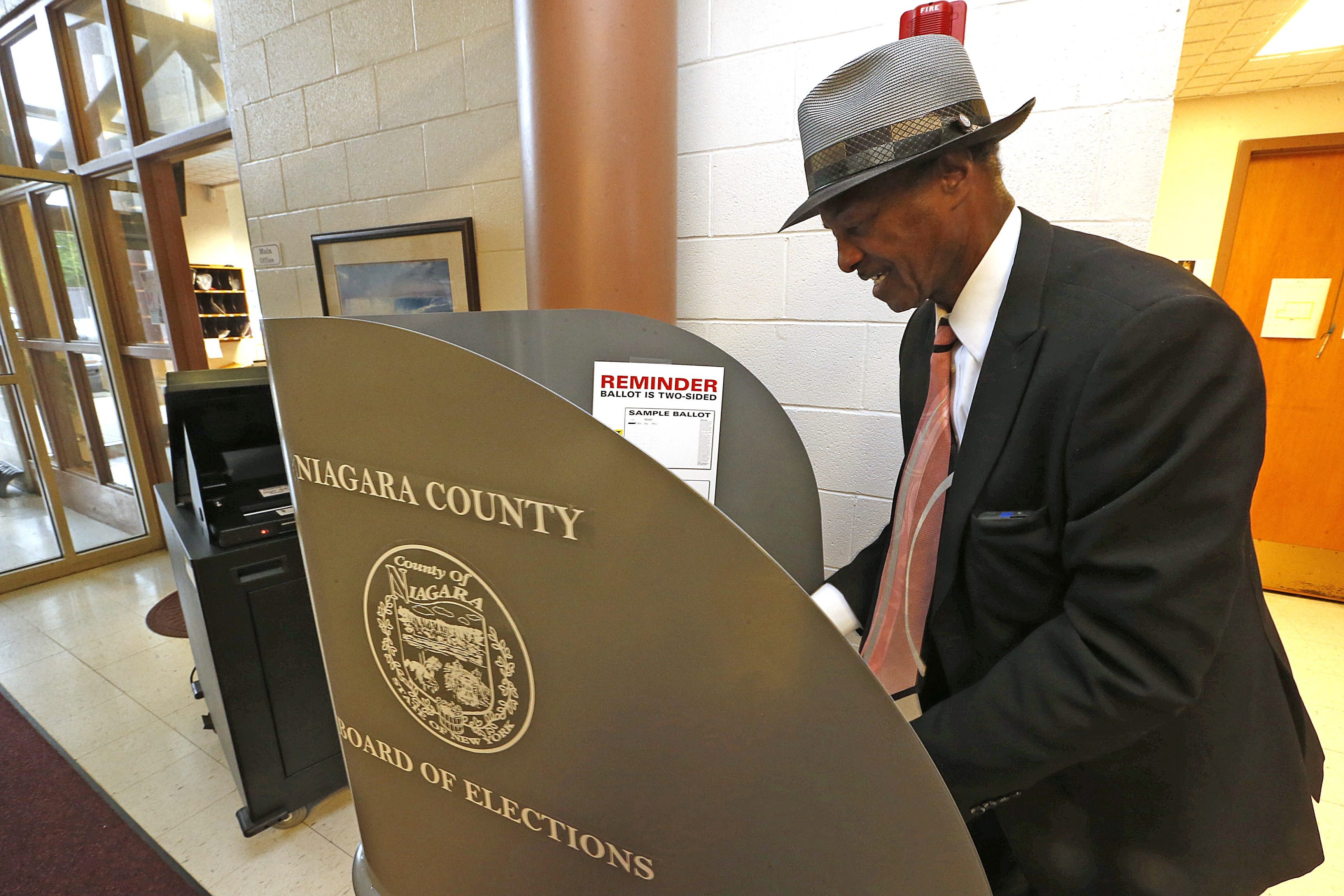 Jesse J. Scott Sr. casts his vote at Maple Avenue Elementary in the Niagara Falls school district, whose budget needed a supermajority to pass.