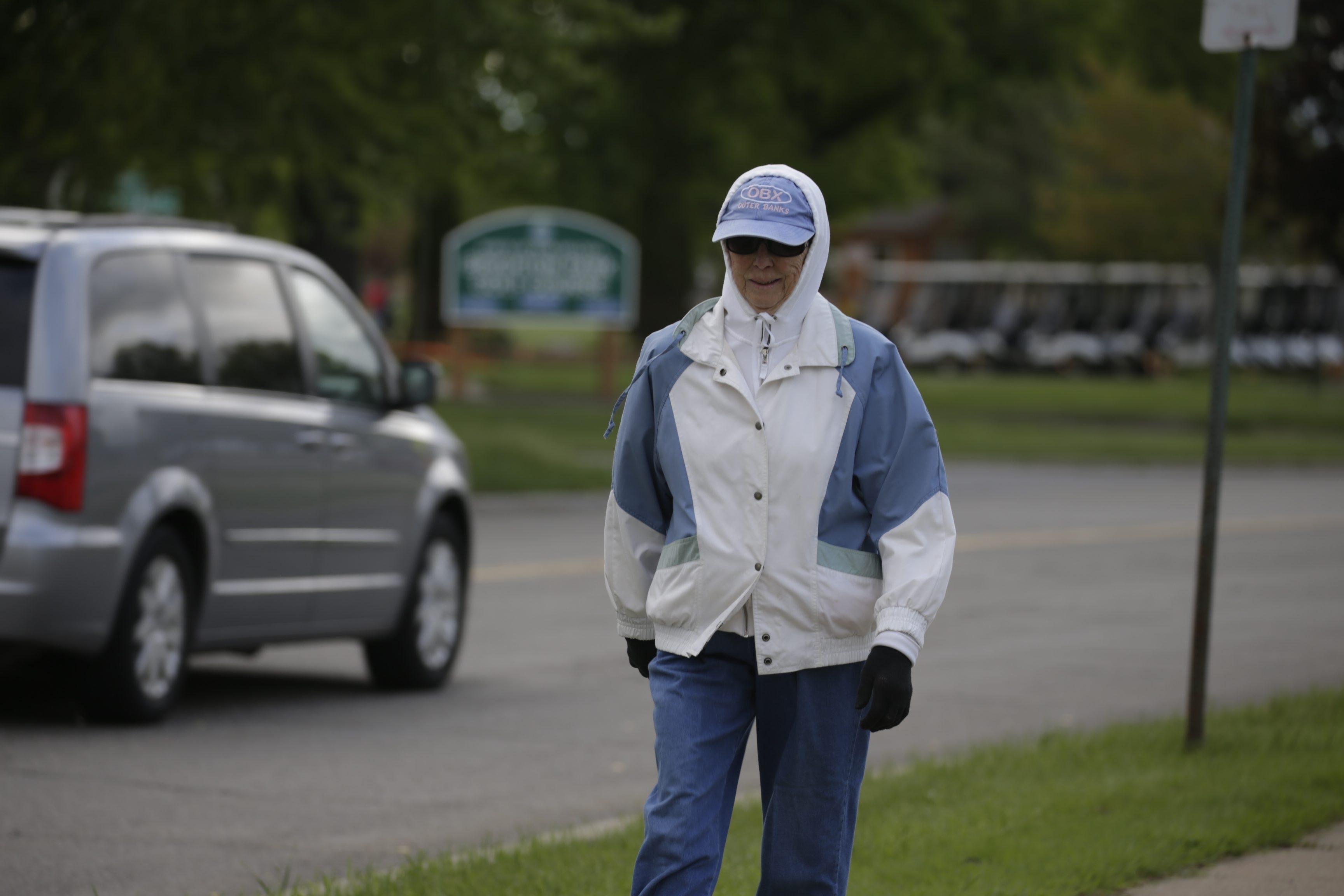 Delores Kellner takes her morning walk on  Brompton Road in Town of Tonawanda, N.Y., on Tuesday, May 19, 2015.   (John Hickey/Buffalo News)
