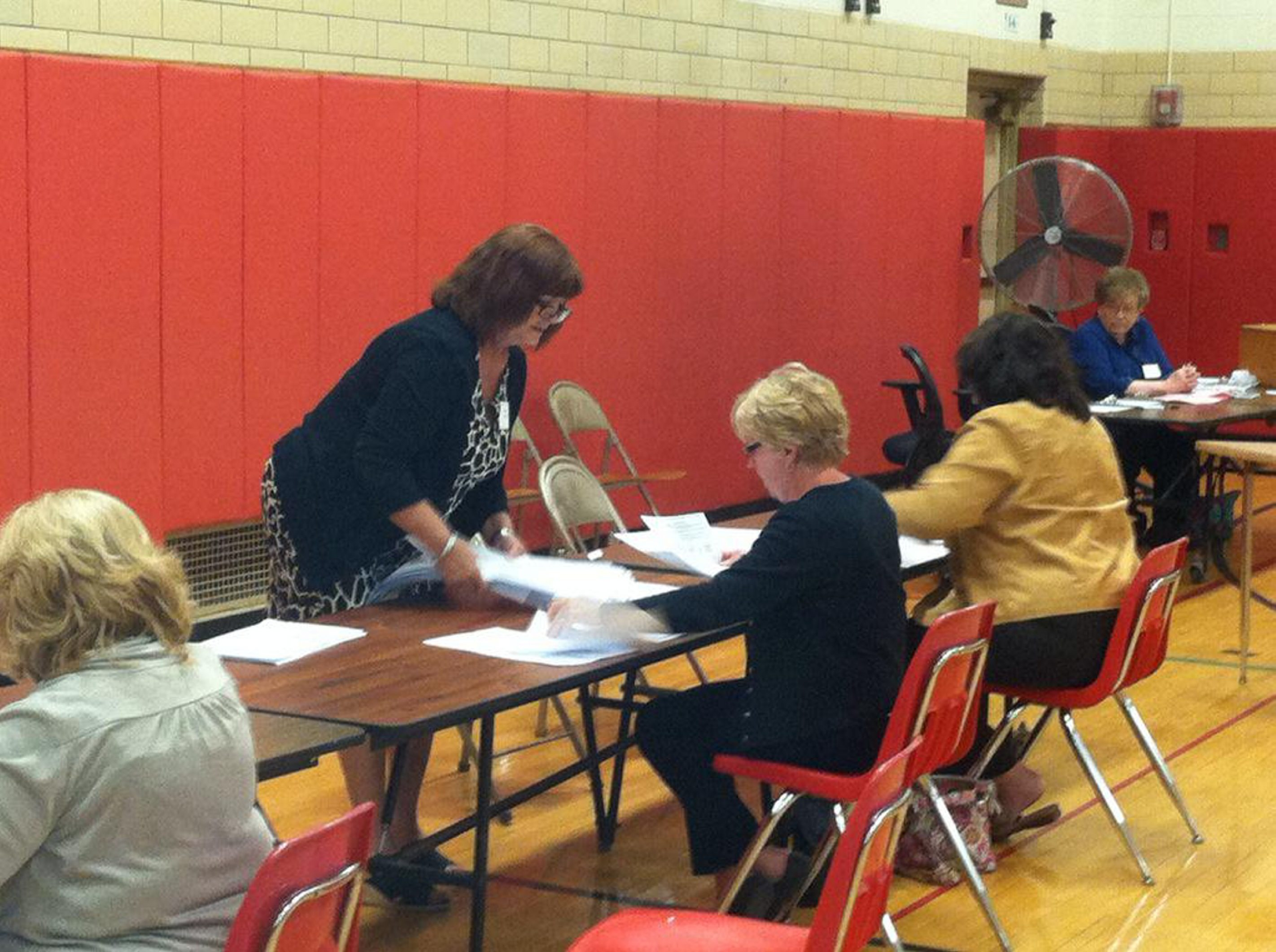 Iroquois voting inspectors begin process of pouring through 1,700 ballots for write-in votes. (John J. Hopkins)