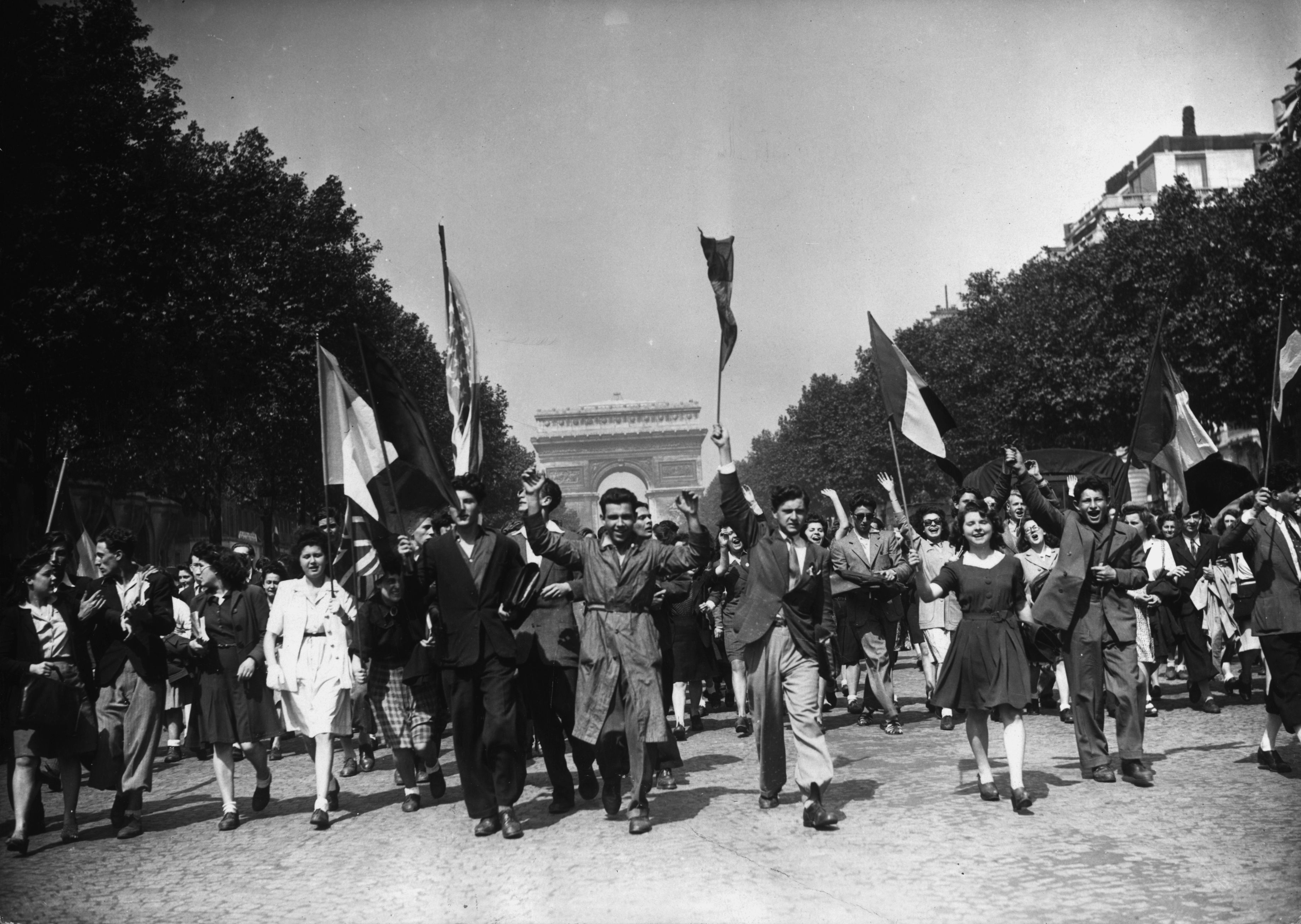 V-E Day 70 years ago touched off large-scale celebrations, including this procession in Paris. (Getty Images)