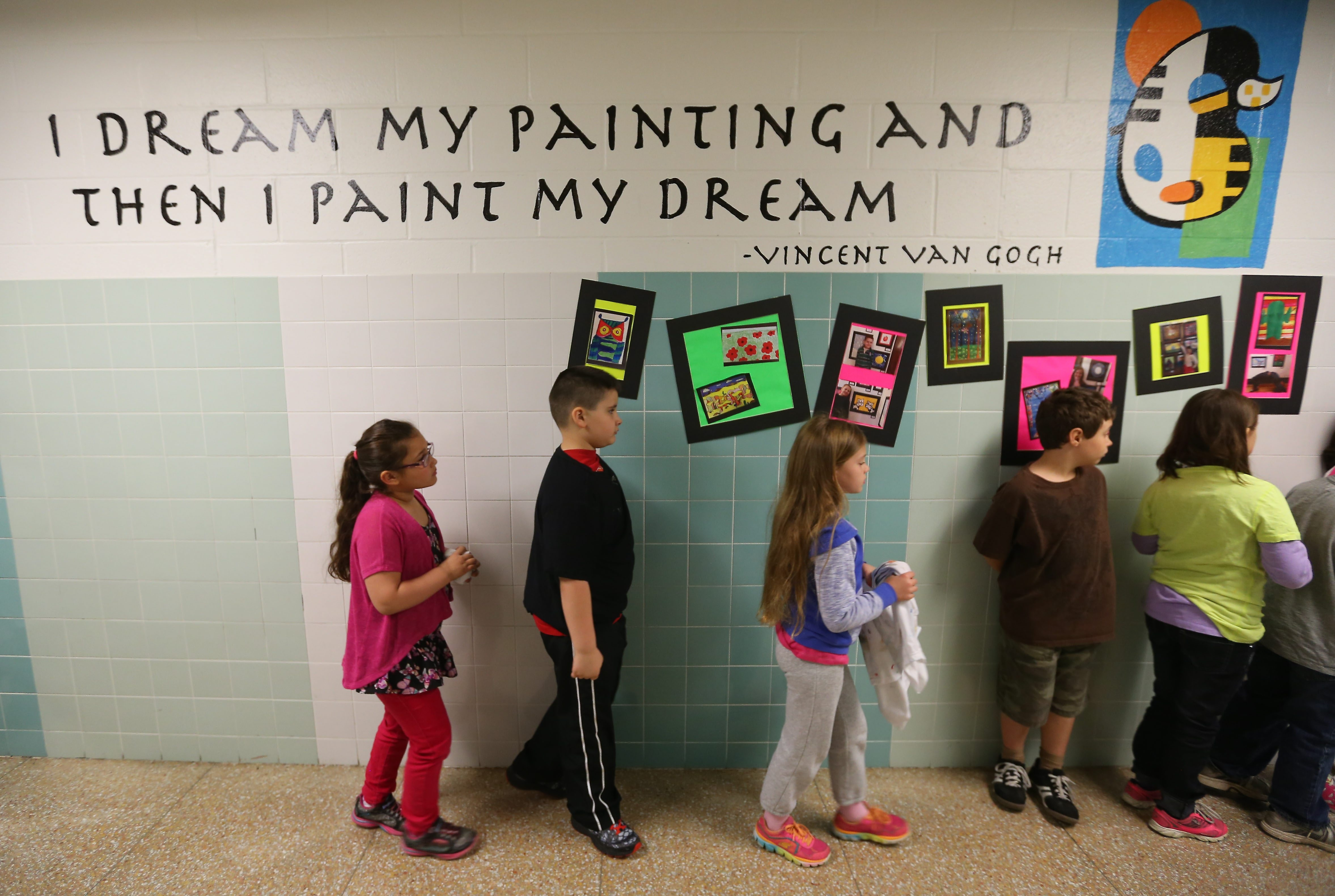Students wait to enter art class at Potters Road Elementary School in West Seneca. The school will close after the school year ends in June.