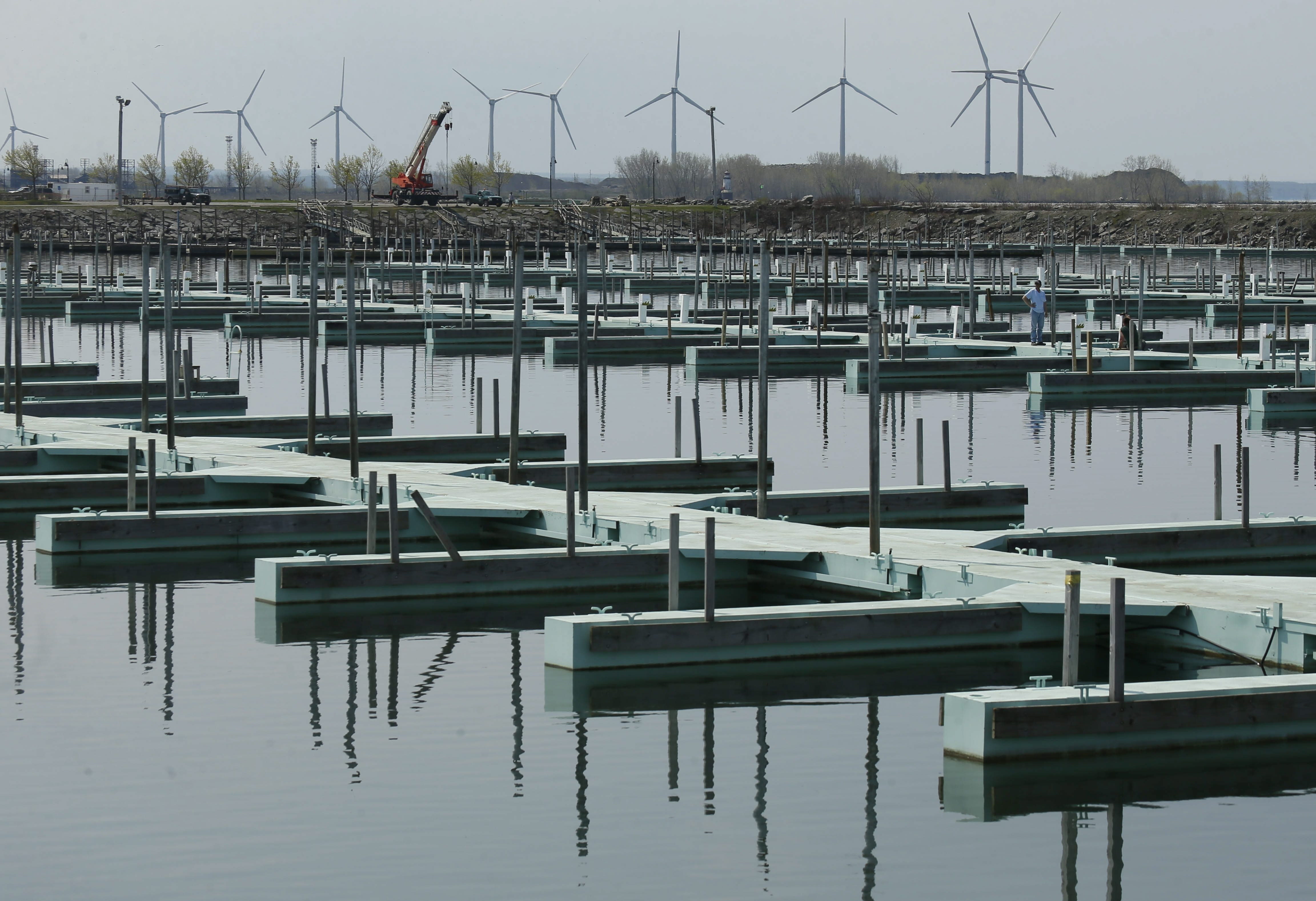 Workers install the docks at the Small Boat Harbor on May 8. (Derek Gee/Buffalo News)