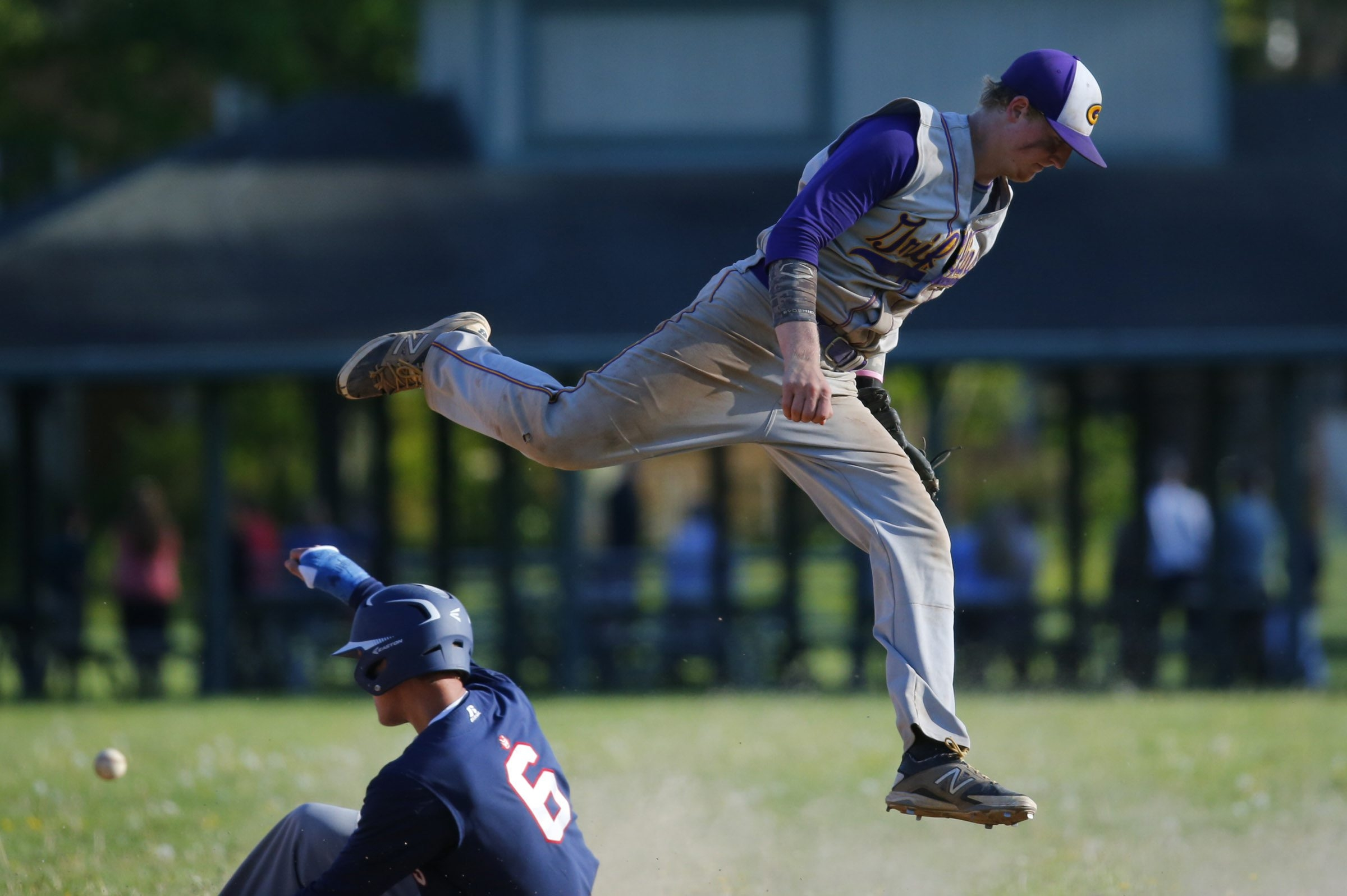 East Aurora's Jack Wolff slides into second base as Springville's Kyle Crotty can't get to the throw during the sixth inning of Thursday's game.
