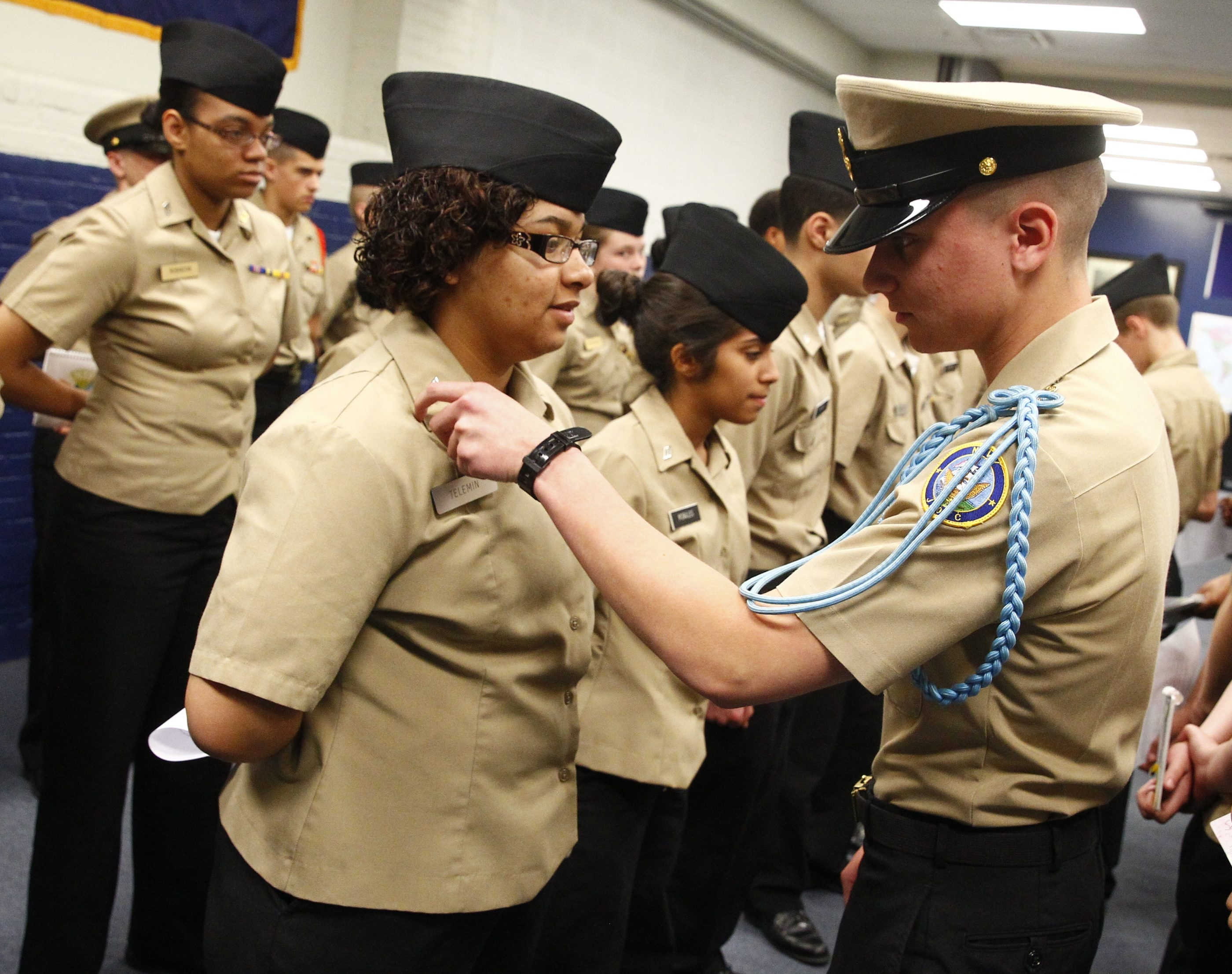 Western New York Maritime Charter School Cadets participate in full uniform inspection at the start of every class on Wednesday's, here  Chief Petty Officer Claudio Benavides, right,  inspects a Cadet at Maritime Charter School in Buffalo, N.Y., on Wednesday, May 6, 2015.  (John Hickey/Buffalo News)
