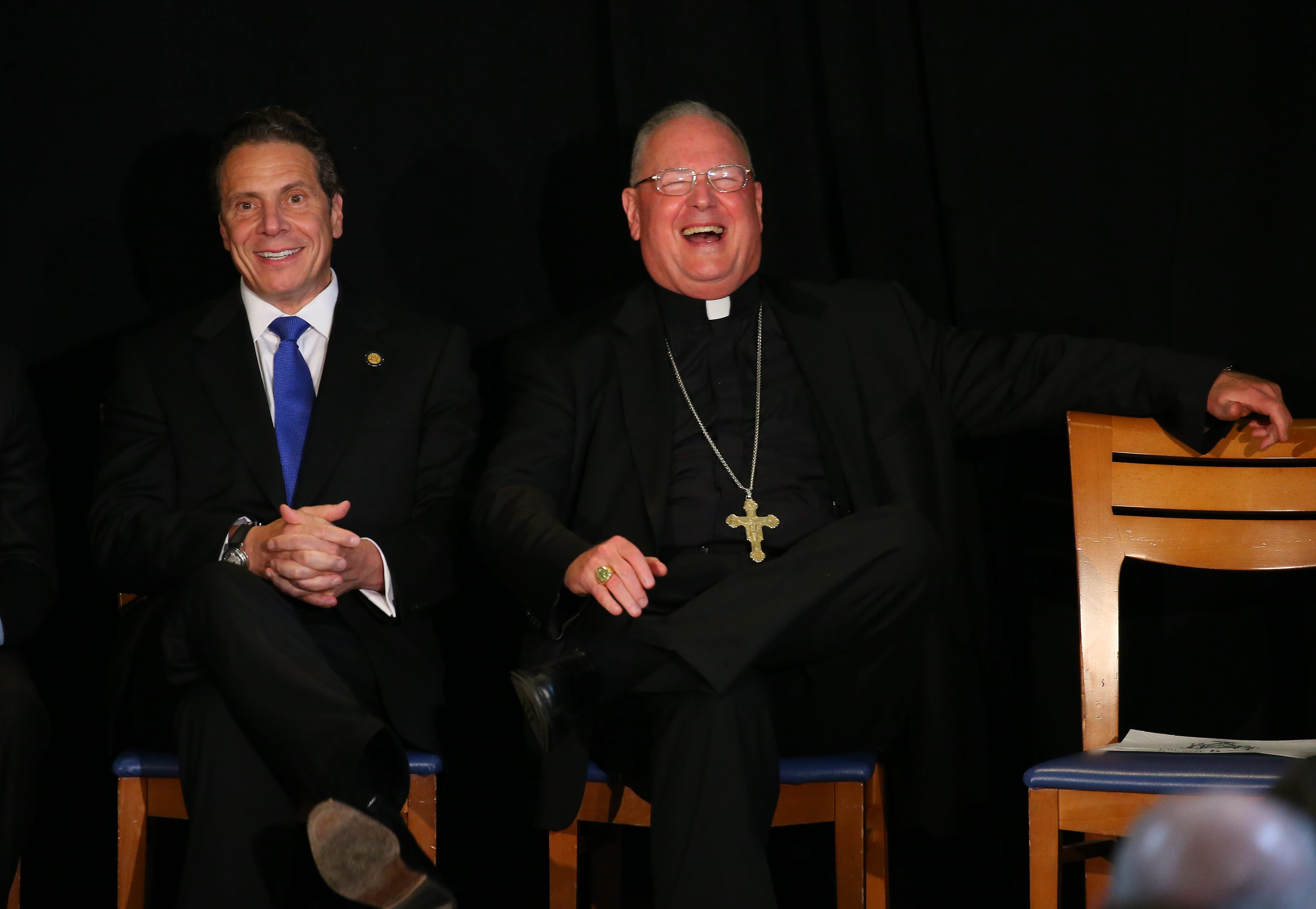 Gov. Andrew M. Cuomo and Cardinal Timothy M. Dolan, Catholic archbishop of New York, share a laugh at a rally for the proposed education tax credit at Eggertsville Youth and Community Center.