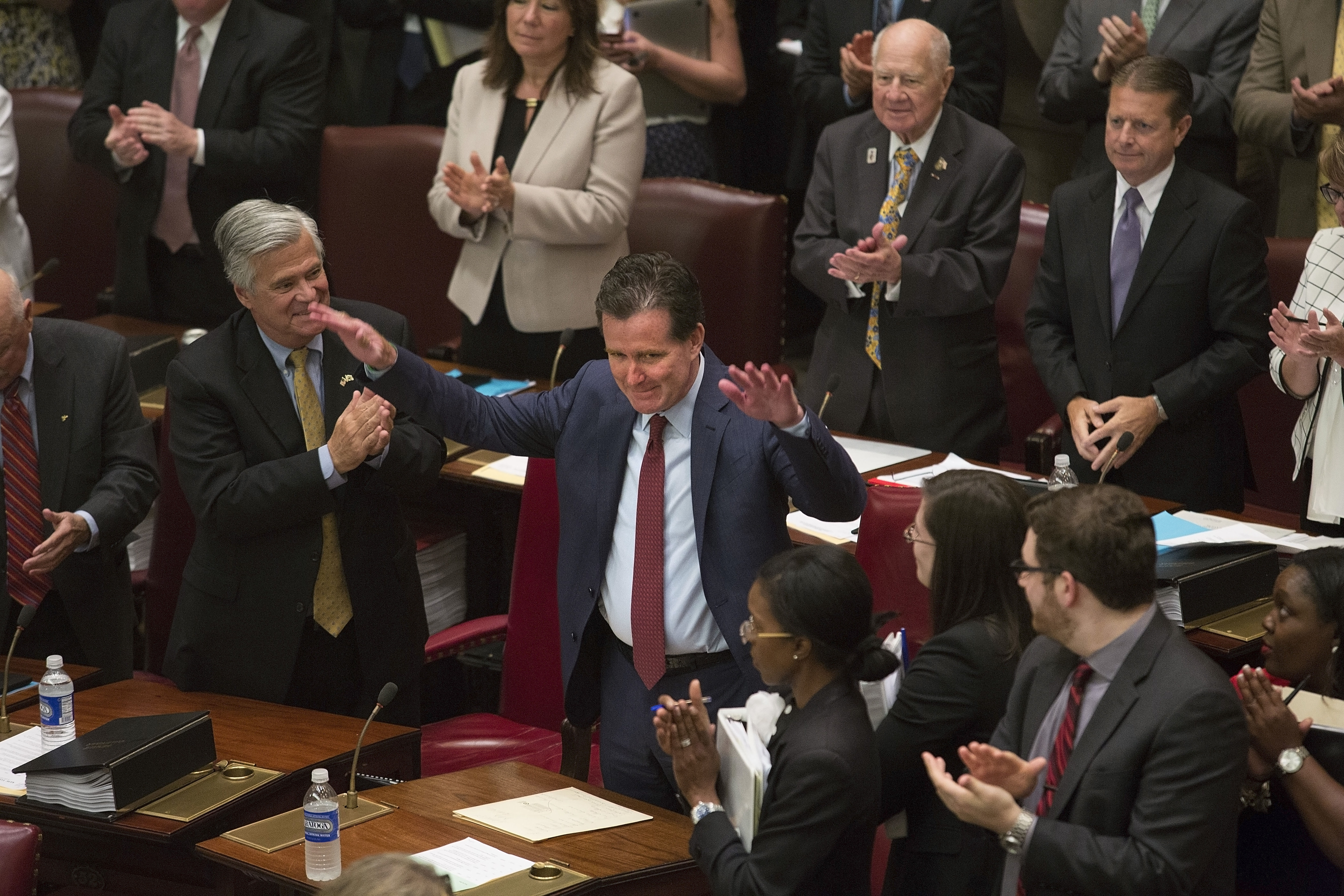 New Majority Leader Republican Sen. John Flanagan acknowledges congratulations from other senators -- including from former Majority Leader Sen. Dean Skelos, left -- on his new role following a formal vote at the Capitol in Albany, N.Y., May 11, 2015. Skelos stepped down from his leadership post after his arrest last week on federal corruption charges. (Nathaniel Brooks/The New York Times)