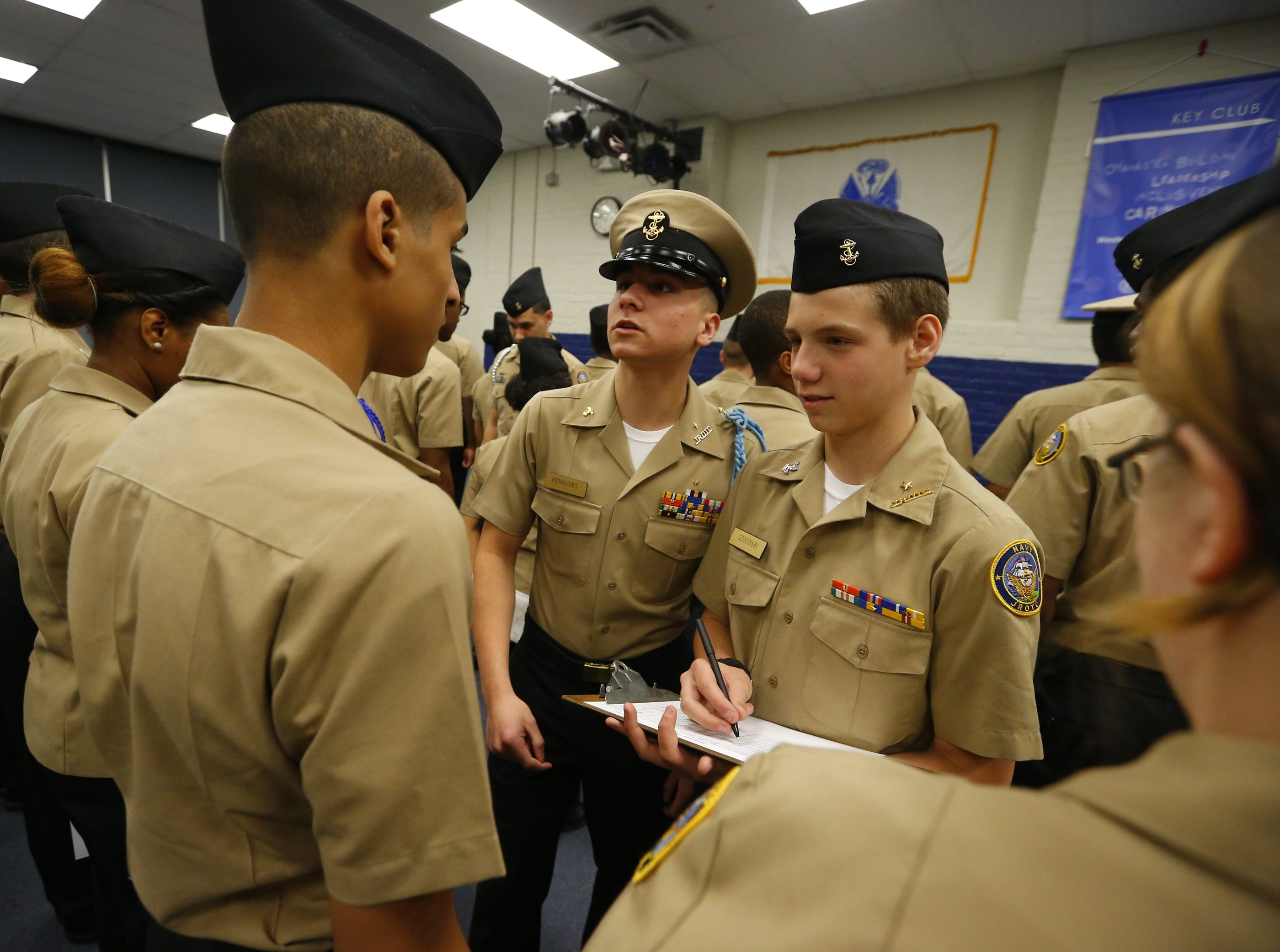 Western New York Maritime Charter School students undergo uniform inspection, this time by Chief Petty Officer Claudio Benavides, center, and Petty Officer 2nd Class Jarek Szopinski last week.