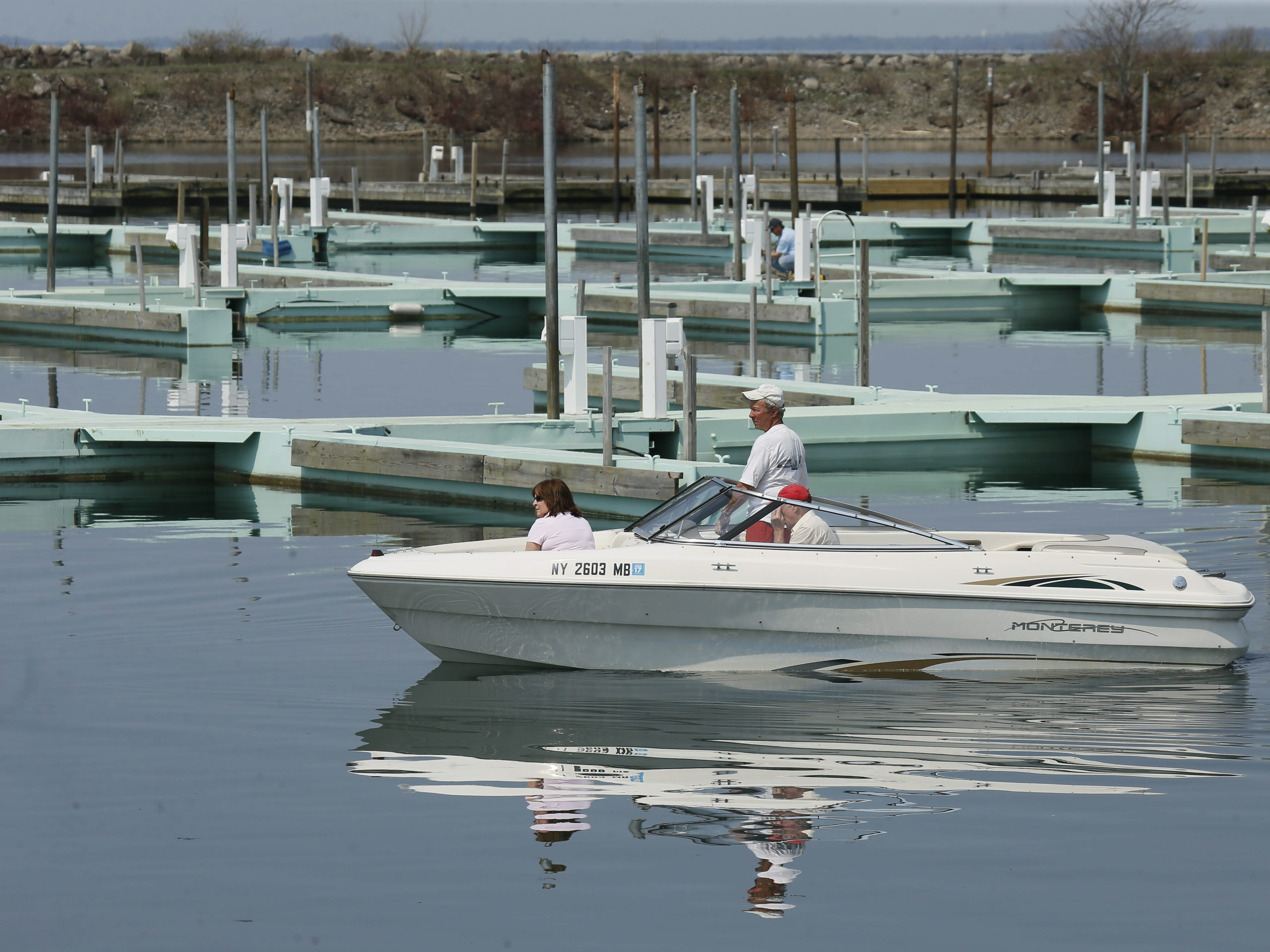 A boater passes the empty docks after launching at the Small Boat Harbor on Friday. Safe Harbor Inc. raised slip fees 7 percent this year.