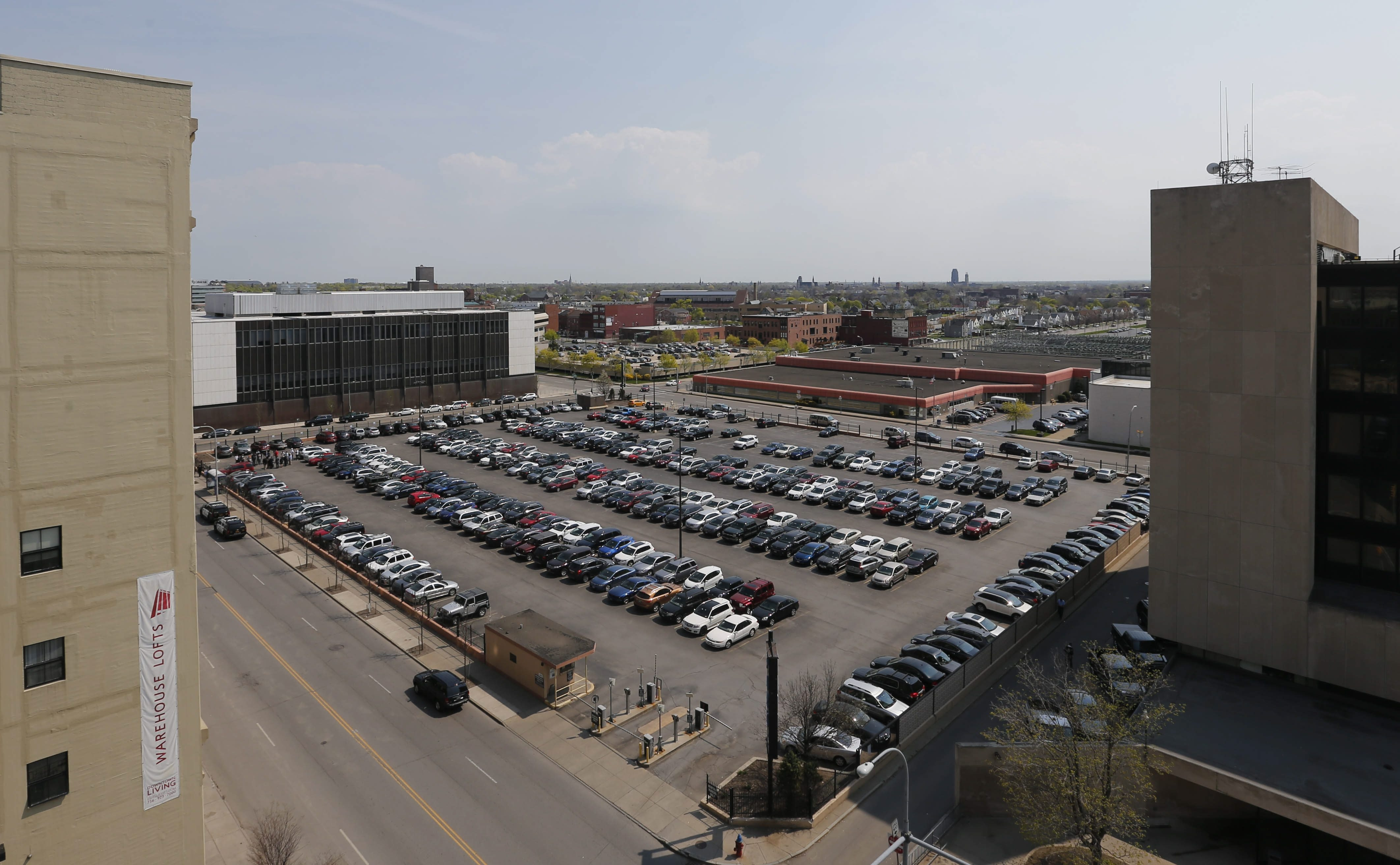 The parking lot on the 200 block of Ellicott Street Where the city has issued RFPs for a grocery store.  (Derek Gee/Buffalo News)