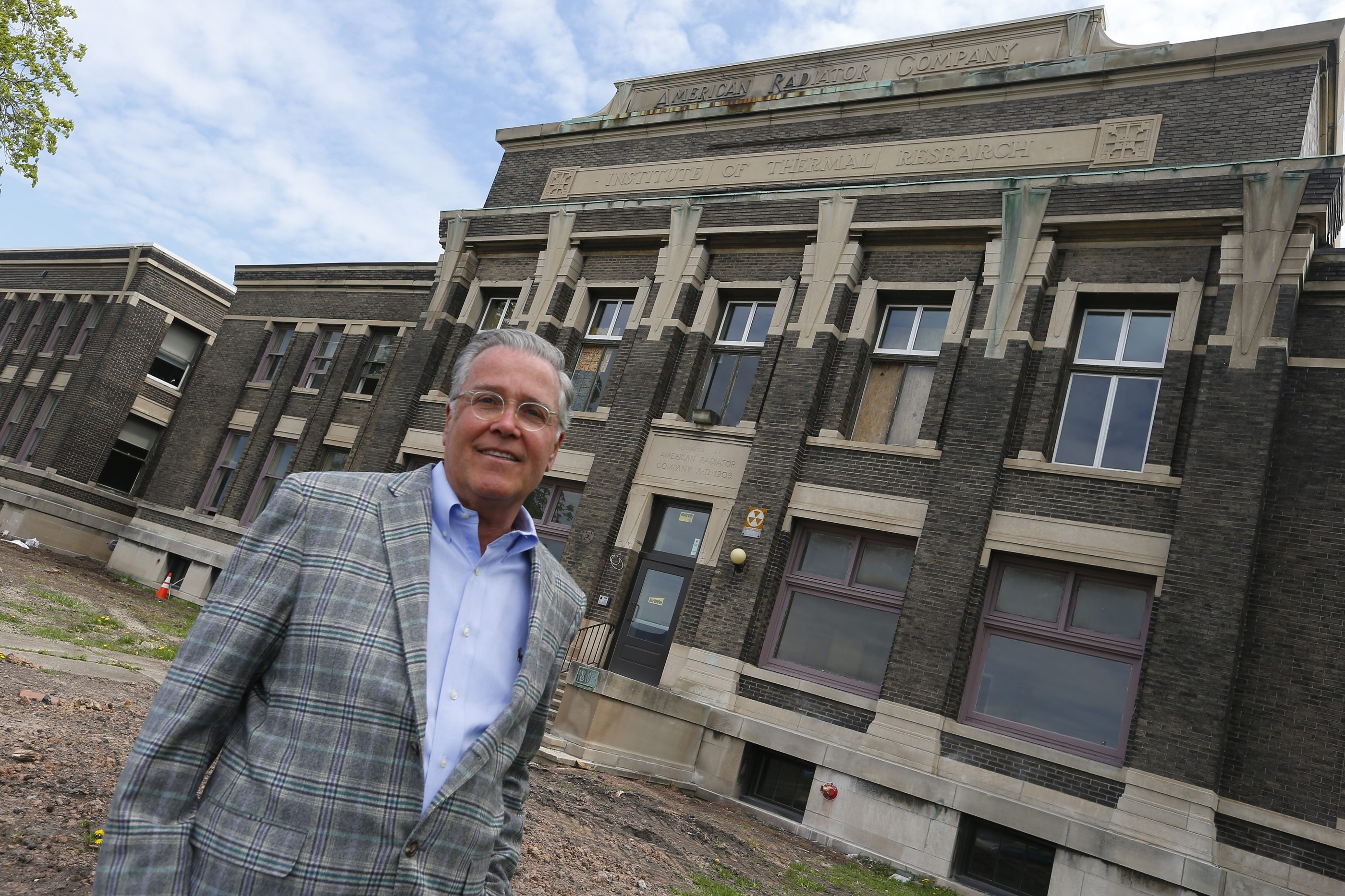 Rocco Termini, in front of his American Radiator Co. building project, has been an active user of historic tax credits for his projects. He credits the state and federal tax programs with helping fuel the redevelopment renaissance going on across Buffalo.