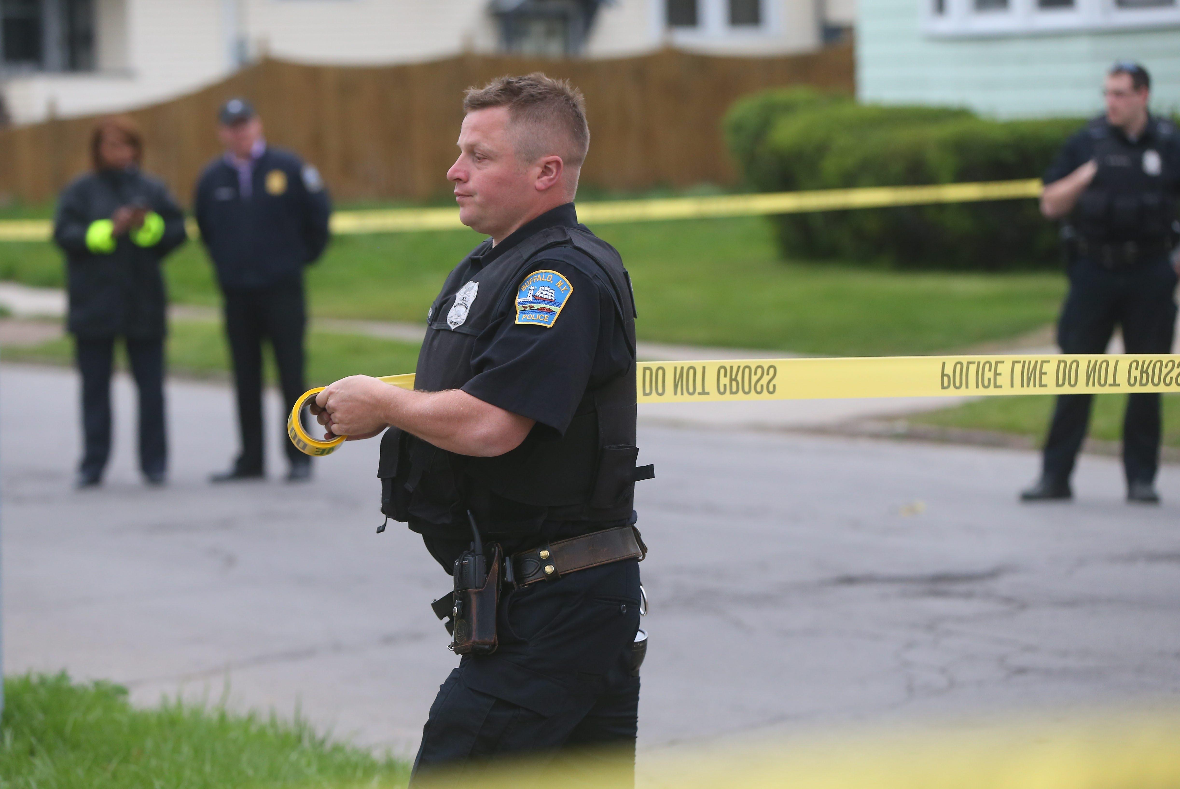Buffalo Police investigate a shooting on Roosevelt Avenue in Buffalo, May 4, 2015.    (Mark Mulville/Buffalo News)