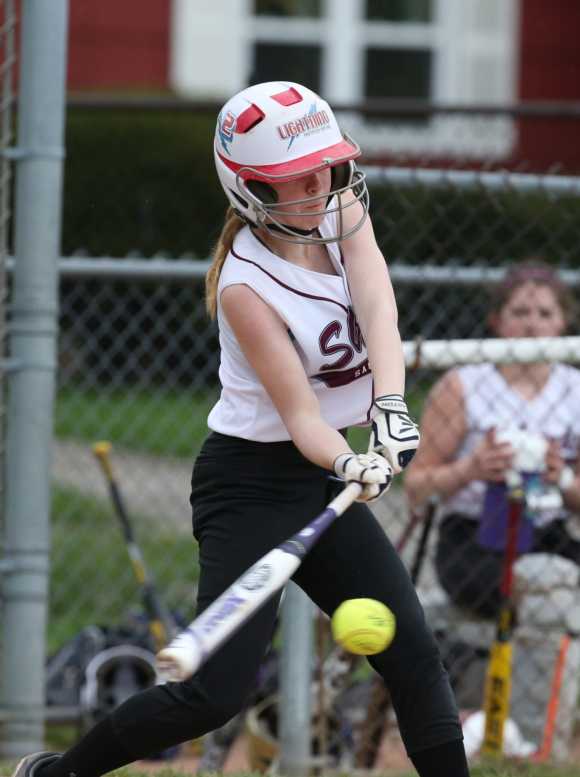 Sacred Heart's Clare Falkowski hits a single against Mount Mercy in the fourth inning at Shoshone Park  in Buffalo,NY on Monday, May 4, 2015.  (James P. McCoy/ Buffalo News)