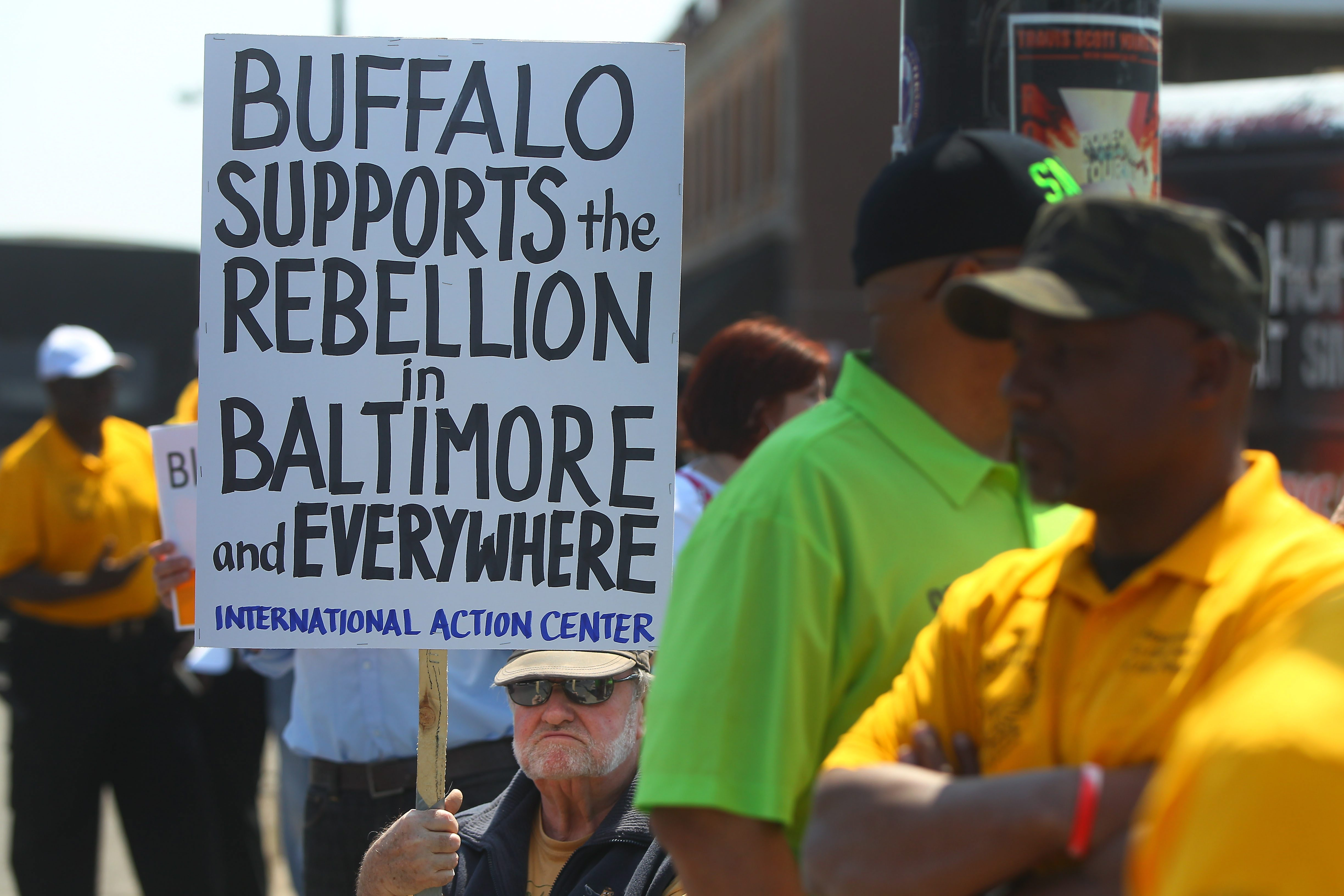 Tom Blake holds a sign as he and other protesters rally against police brutality at the corner of Bailey and Kensington avenues in Buffalo on Sunday.