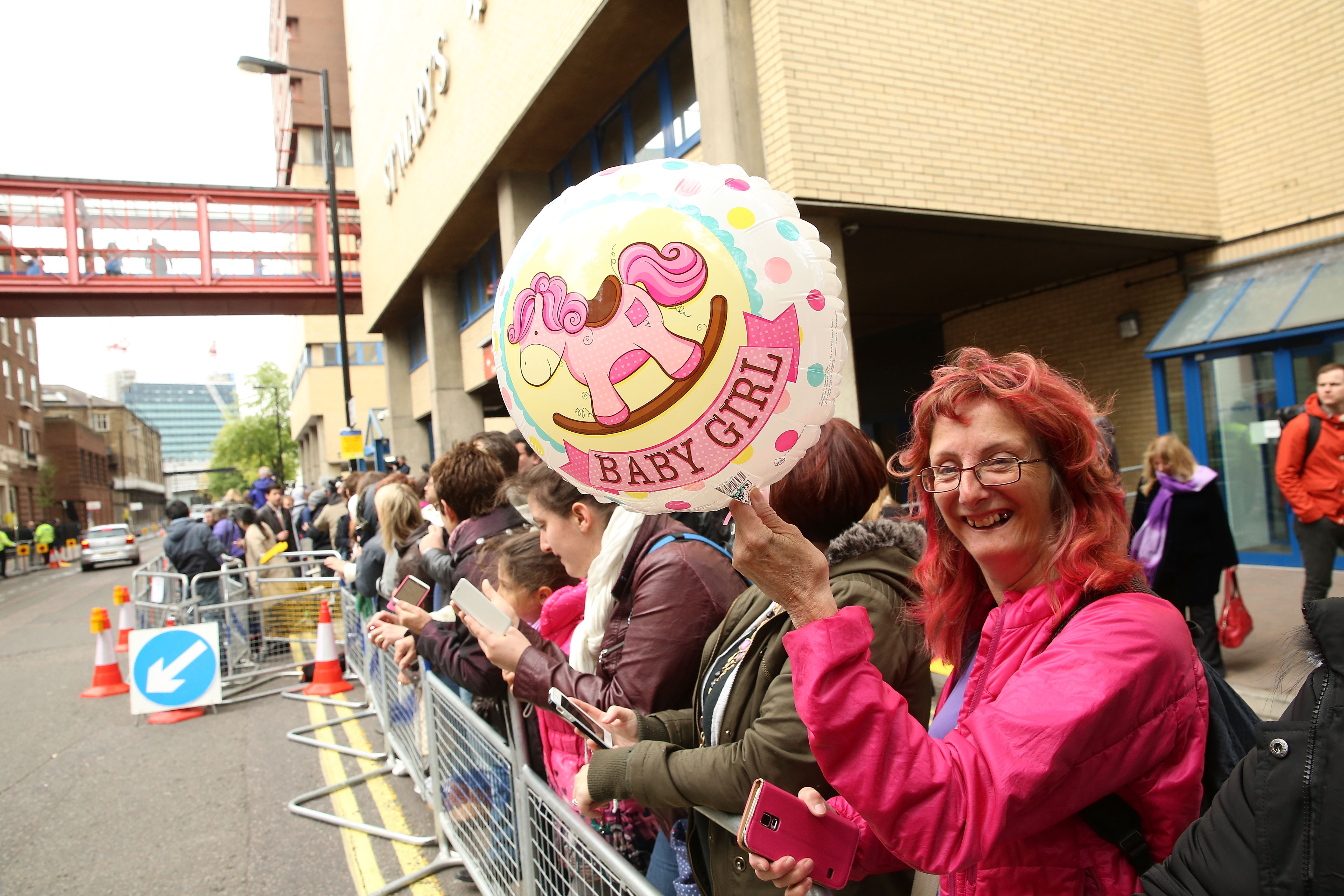 Royal fans celebrate the announcement that Catherine, duchess of Cambridge, has given birth to a baby girl, outside the Lindo Wing at St Mary's Hospital on May 2 in London.