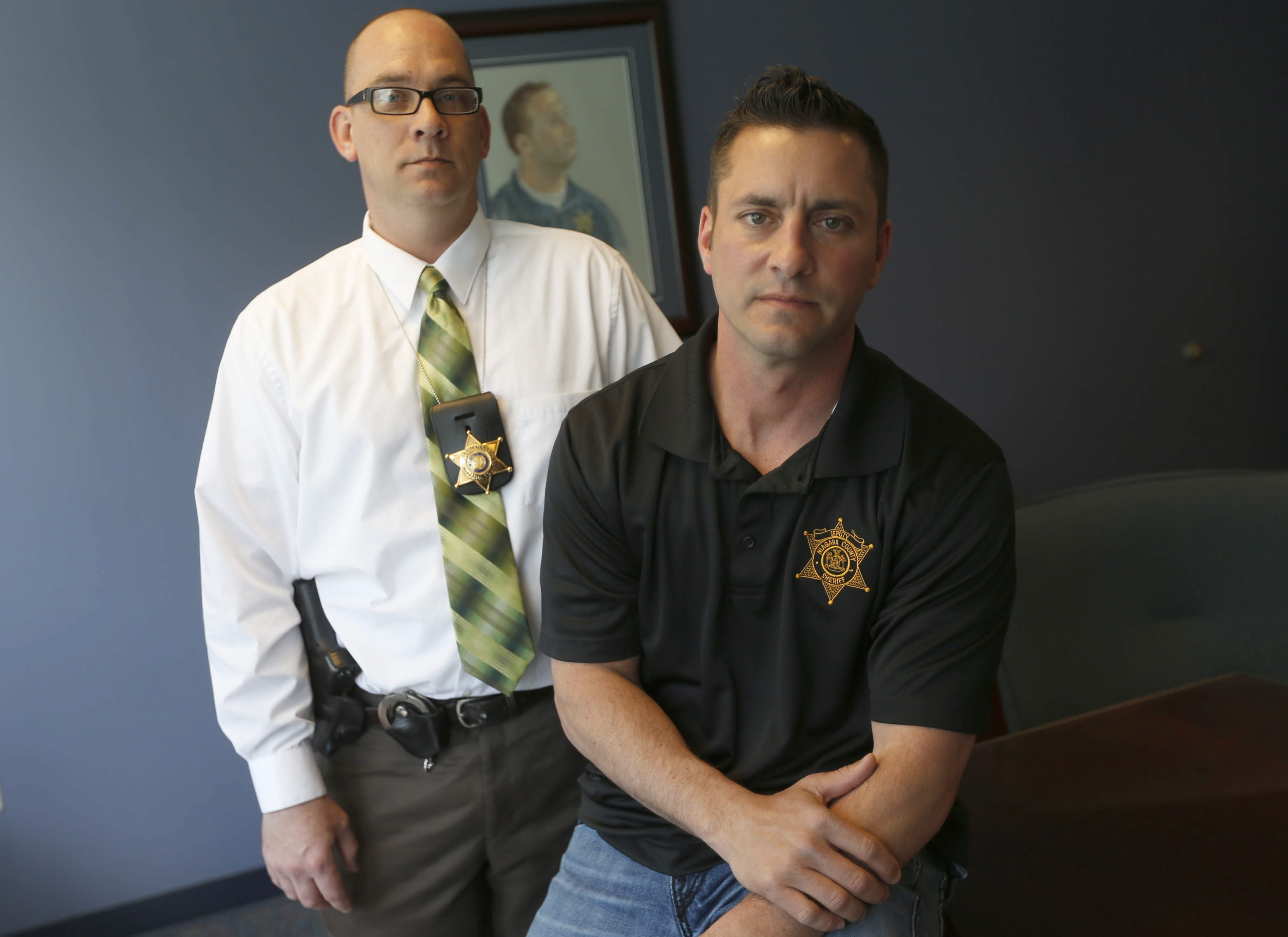 Niagara County Sheriff's Deputy Joseph L. Tortorella, right, was aided by Lt. Cory Diez after the shootout.