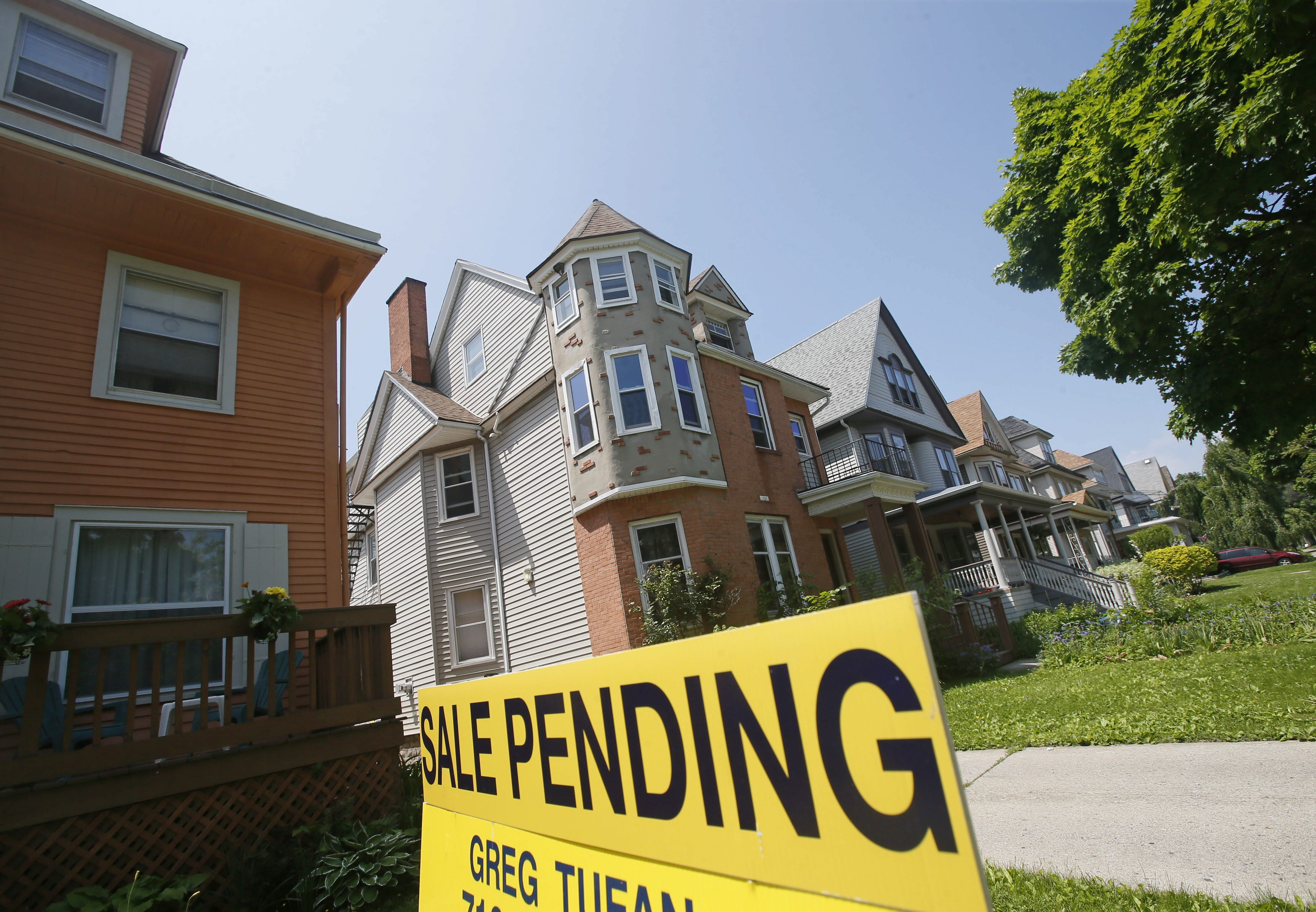 A real estate sign advertises a home under contract for sale on Norwood Avenue in the Elmwood Village, Tuesday, June 3, 2014.  (Derek Gee/Buffalo News)