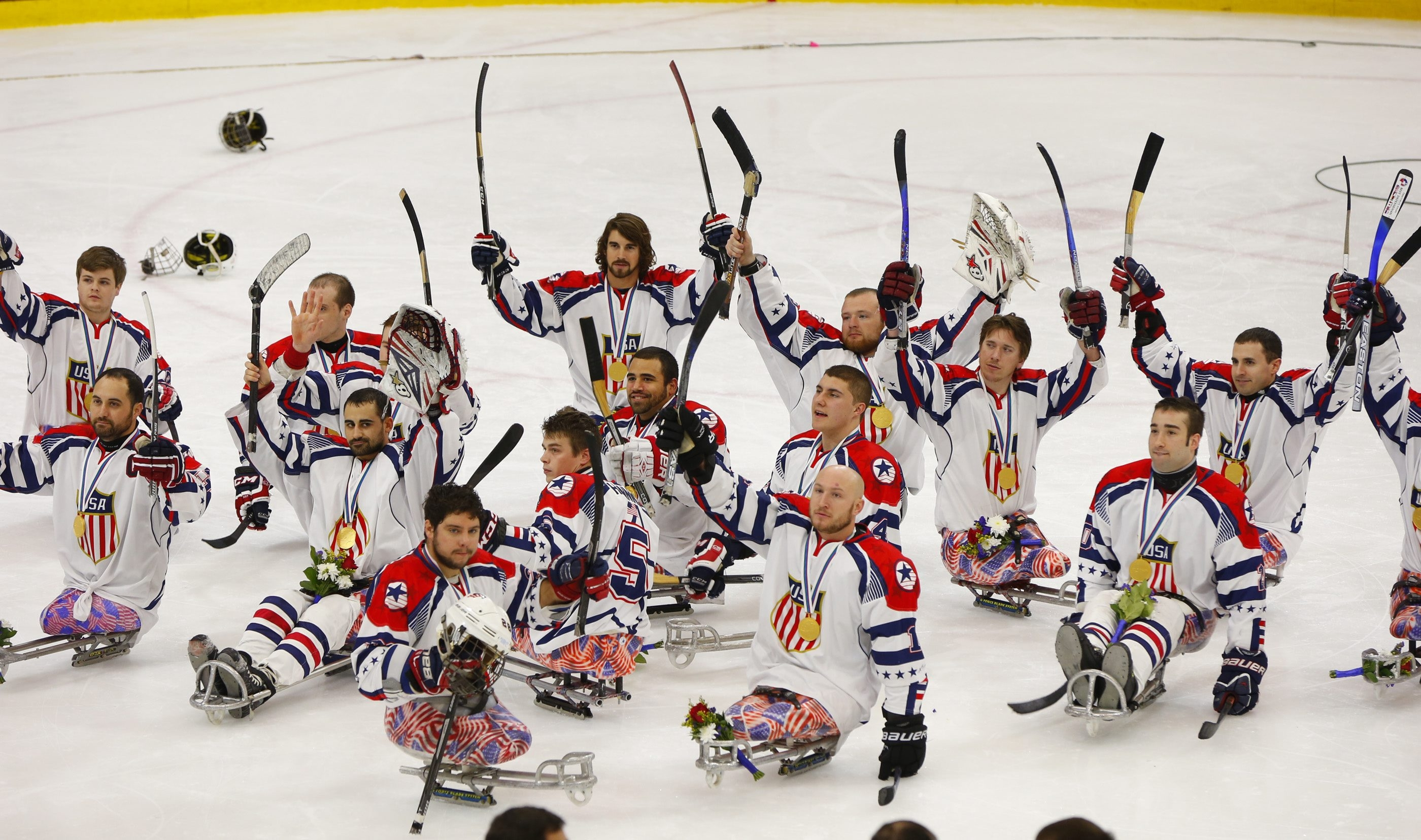 USA sledge hockey players salute the fans at HarborCenter after defeating Canada in the world championship.