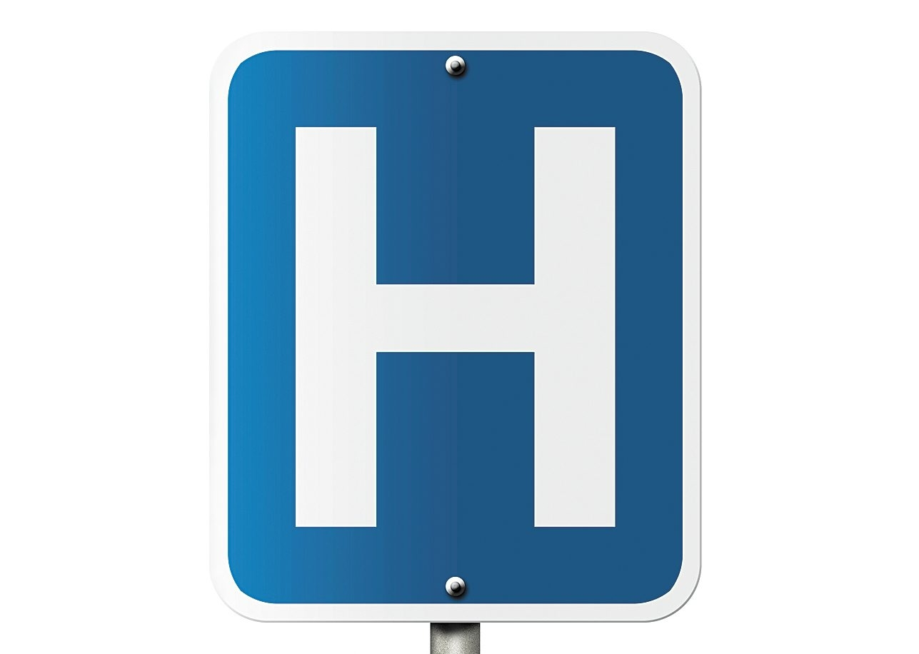 An American road sign isolated on white with a capital H and word Hospital, Hospital Sign