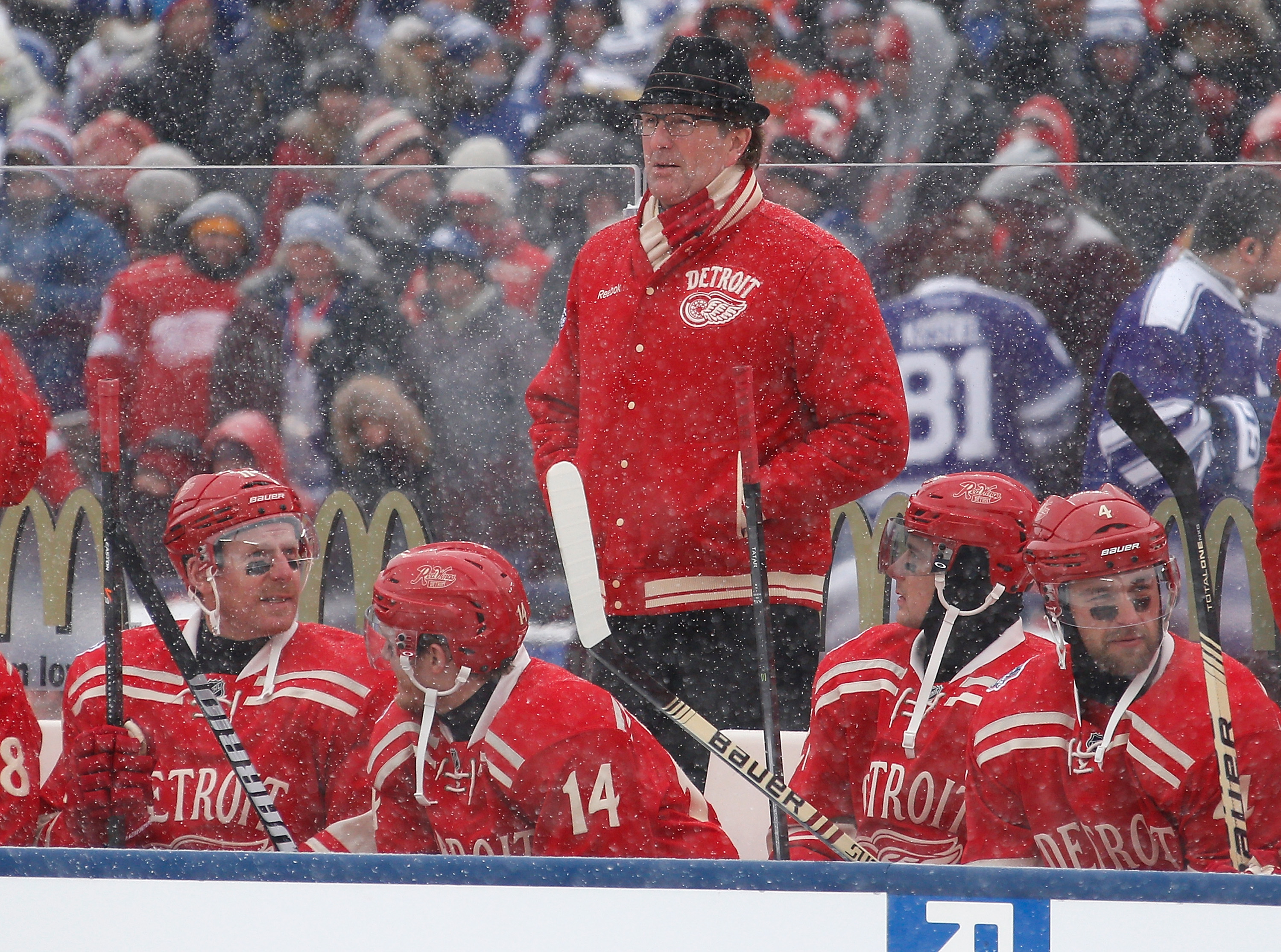 Mike Babcock was resplendent in old-school jacket, scarf and fedora at the 2014 Red Wings-Leafs Winter Classic in Ann Arbor, Mich. (Getty Images).