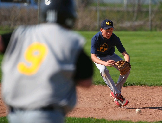 Niagara Falls Mason Hilliard fields a grounder during a modified baseball game with Charter School for the Applied Technologies in the Town of Tonawanda on Thursday, Buffalo's first 80-degree day this year. (Mark Mulville/Buffalo News)
