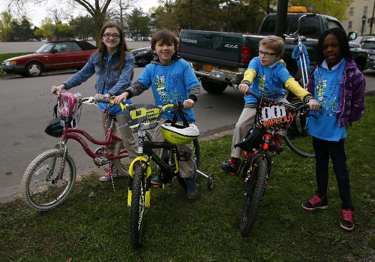 May is National Bike Month and a variety of activities have been planned in Buffalo, including a family bike ride on Sunday. Among those who participated earlier this month in Bike to School Day were from left, Gianna Williams, 11, and her brothers Joshua, 8, and Jeremiah , 10, with classmate Makayla Walker, all from School No. 54 . (John Hickey/Buffalo News)