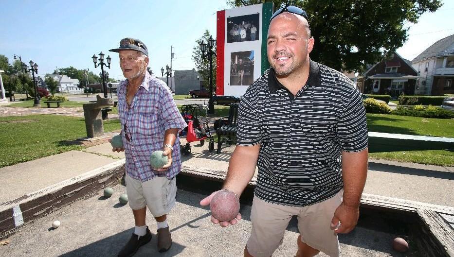 Carmine Bianco, right, plays bocce in 2013. Bianco, chairman of the Niagara Falls Italian Festival, is opening his own restaurant on Pine Avenue. (Robert Kirkham/Buffalo News file photo)