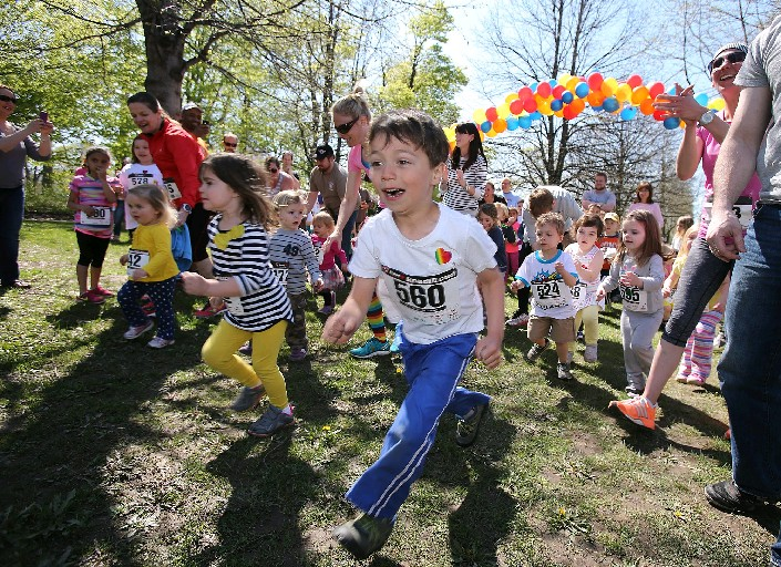 Henry Martinez, then 6, of Amherst, center, dashes ahead in the 4- to 6-year-old division of the Little Peanut Stampede, following the 8th Annual Elephant Run last Mother's Day to benefit organ transplant recipients. (Buffalo News file photo)