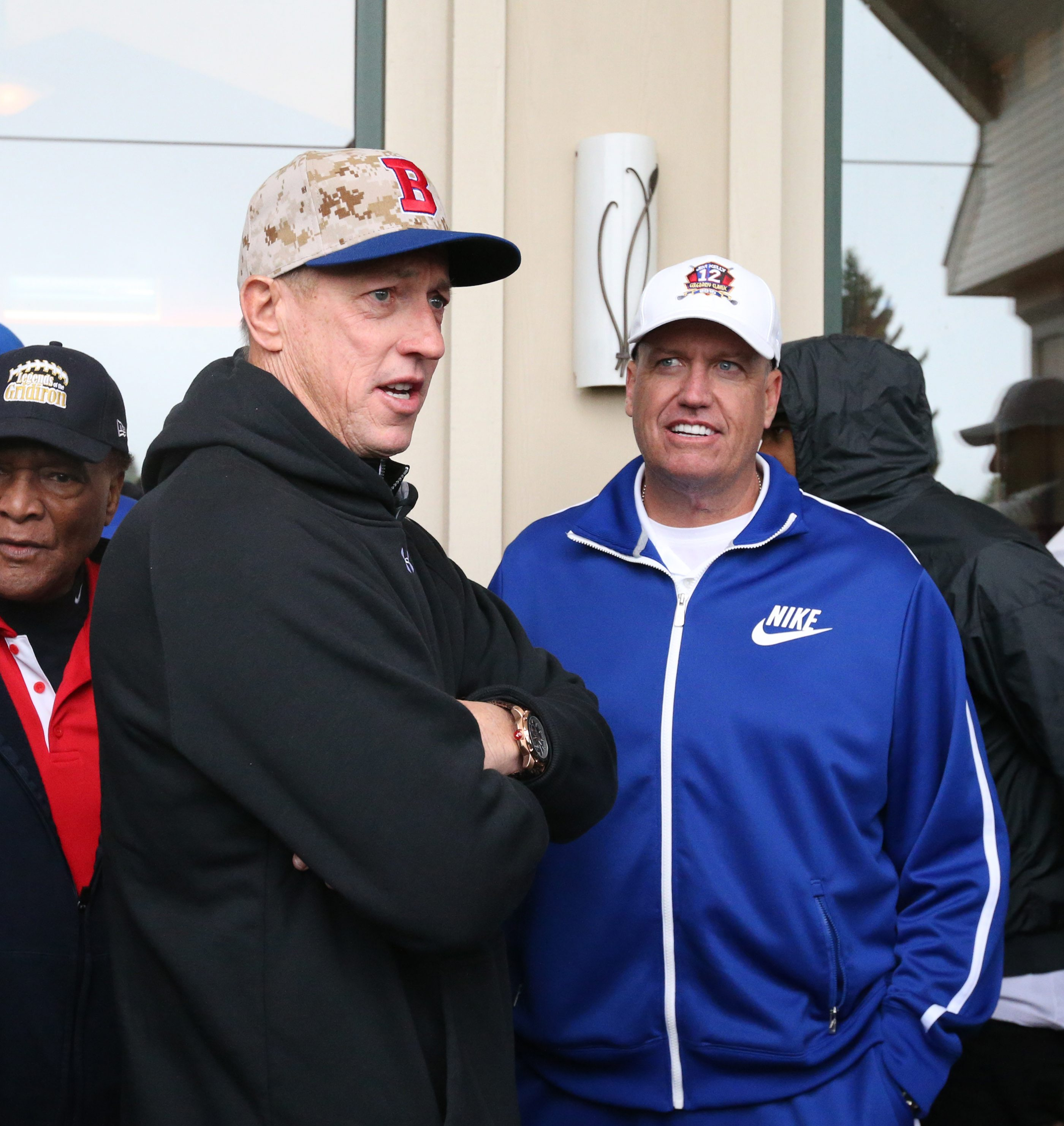Jim Kelly talks to  Rex Ryan and other players at his own Jim Kelly's 29th Celebrity Classic golf tournament at Terry Hills Golf Course in Batavia,NY on Monday, June 1, 2015.  (James P. McCoy/ Buffalo News)
