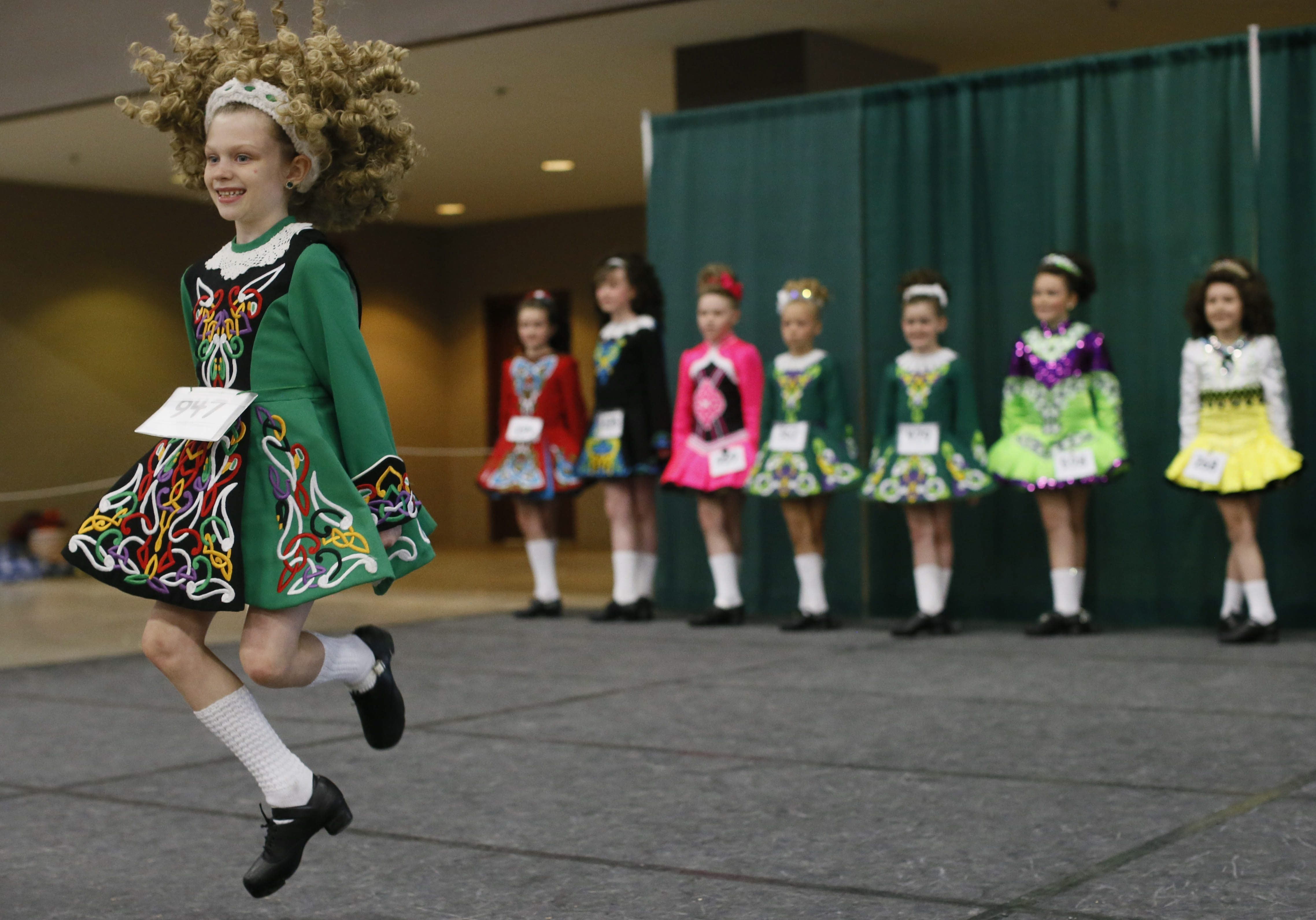 Maeve Lickfeld, 8, of Buffalo, takes her turn Irish dancing for the judges at the 50th annual Buffalo Feis at the Fairgrounds Event Center on Saturday in Hamburg.