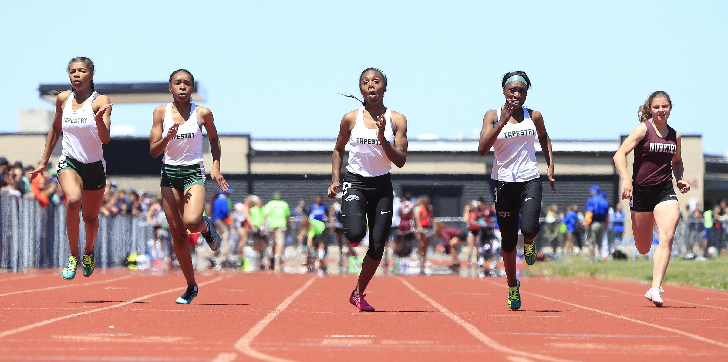 Taylor Alston, second from the right, leads the Tapestry charge to the finish line in the Division II 100-meter dash during the Section VI track and field championships at Niagara-Wheatfield.