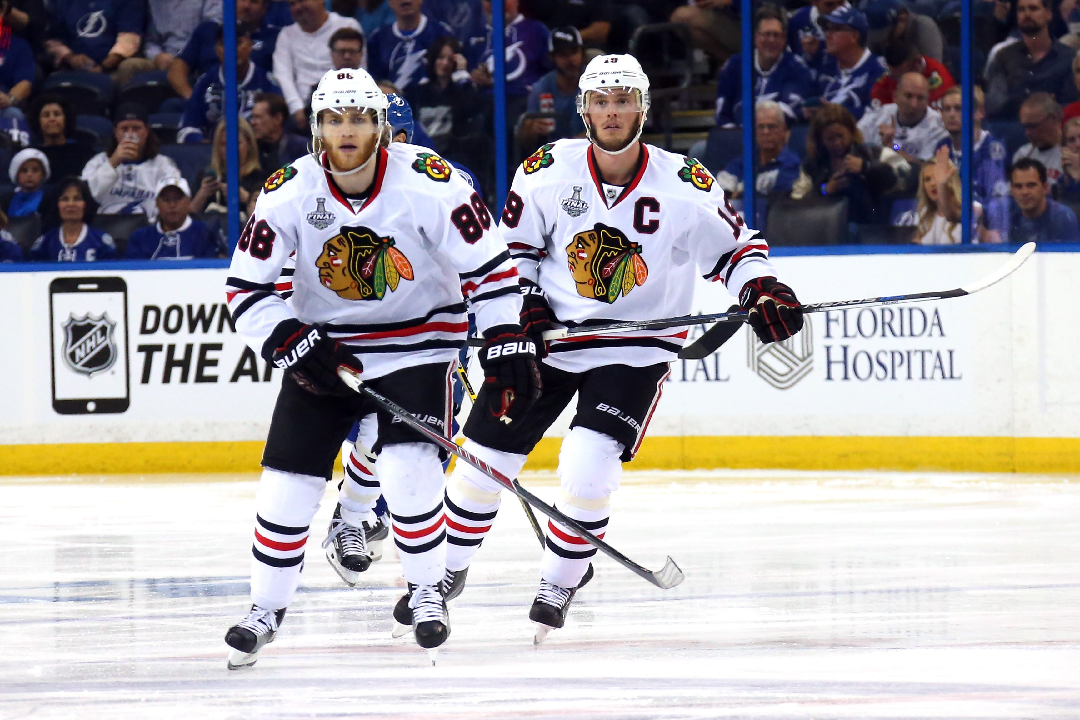 Patrick Kane, left, and captain Jonathan Toews will be on different lines when the Blackhawks face the Lightning in Game Three on Monday night.