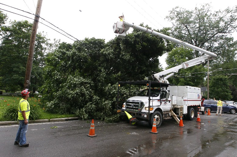 Mike Scroger a foreman with Lewis Tree Service works on a tree that fell on power lines at the corner of Center and Oakwood streets in East Aurora, on Tuesday, after in line of thunderstorms associated with a strong cold front passed through Western New York before dawn leaving more than 17,000 utility customers without power. (John Hickey/Buffalo News)