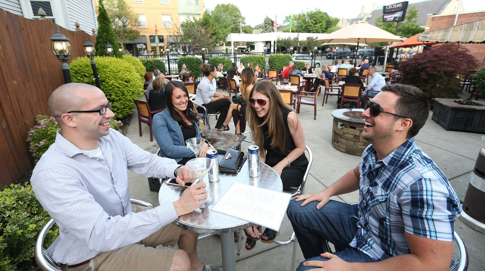 Eating, drinking and hanging out on patios in Western New York is a fine way to spend an evening. (Sharon Cantillon/Buffalo News)