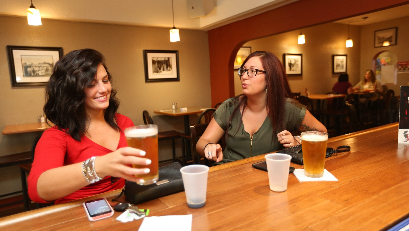 Alexa Fleming of Eden and Justice Ring of Hamburg have a couple of beers at Coyote Cafe in Hamburg. (Sharon Cantillon/Buffalo News)