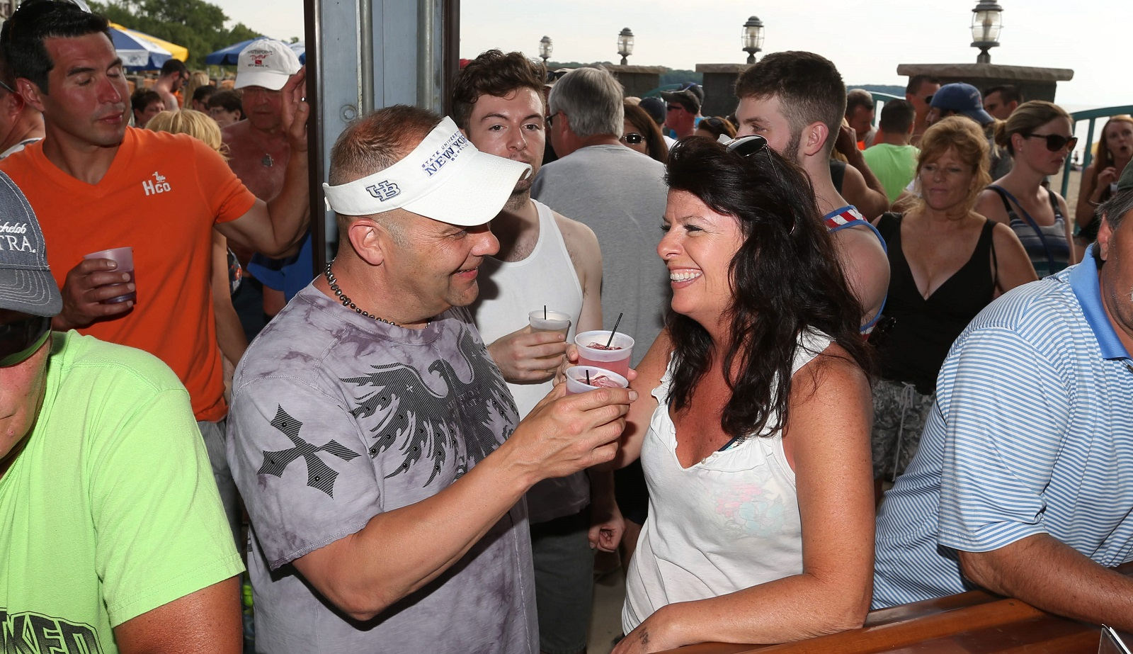 Tom Frost and Peggy Bruso of Williamsville enjoy their drinks at Cabana Sam's patio bar.  (Sharon Cantillon/Buffalo News)