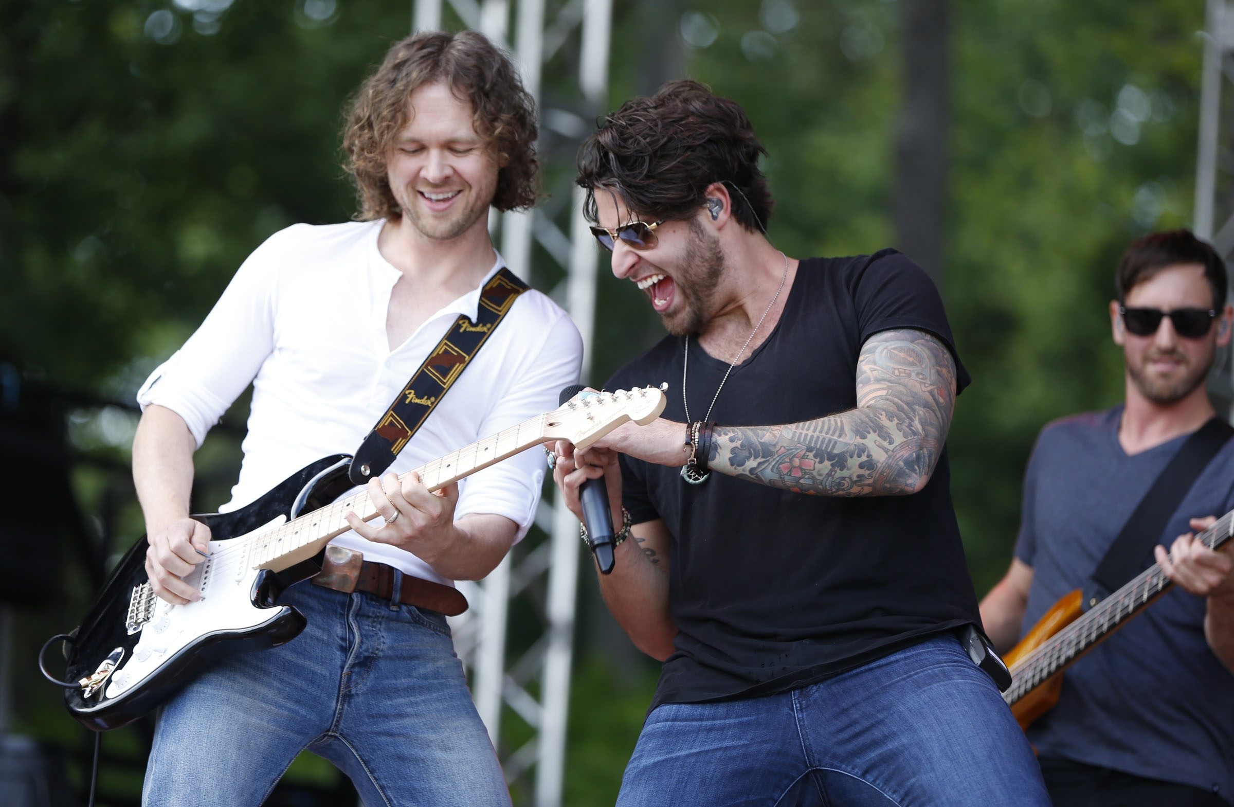 Austin Webb, right, and his gang of four rock-'n'-rollers brought a mixture of alt-country, Top-40 and thumping rock to Friday's Jam in the Valley lineup. The festival continues today in Varysburg with performances by Chris Young, Parmalee and Dallas Smith, among others.