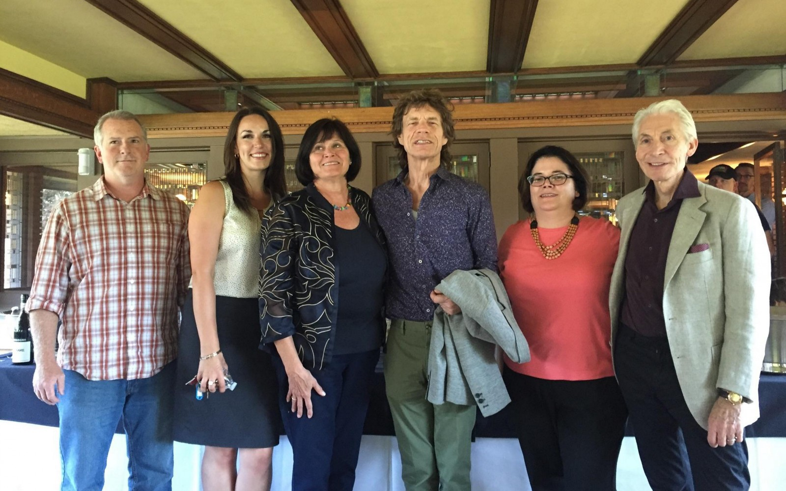 Mary Roberts, executive director of the Martin House Restoration Corp., third from left, gave a private tour Friday of the Darwin Martin complex to Mick Jagger, center, and Charlie Watts, right, of the Rolling Stones. (Photo courtesy Darwin Martin Restoration Corp.)