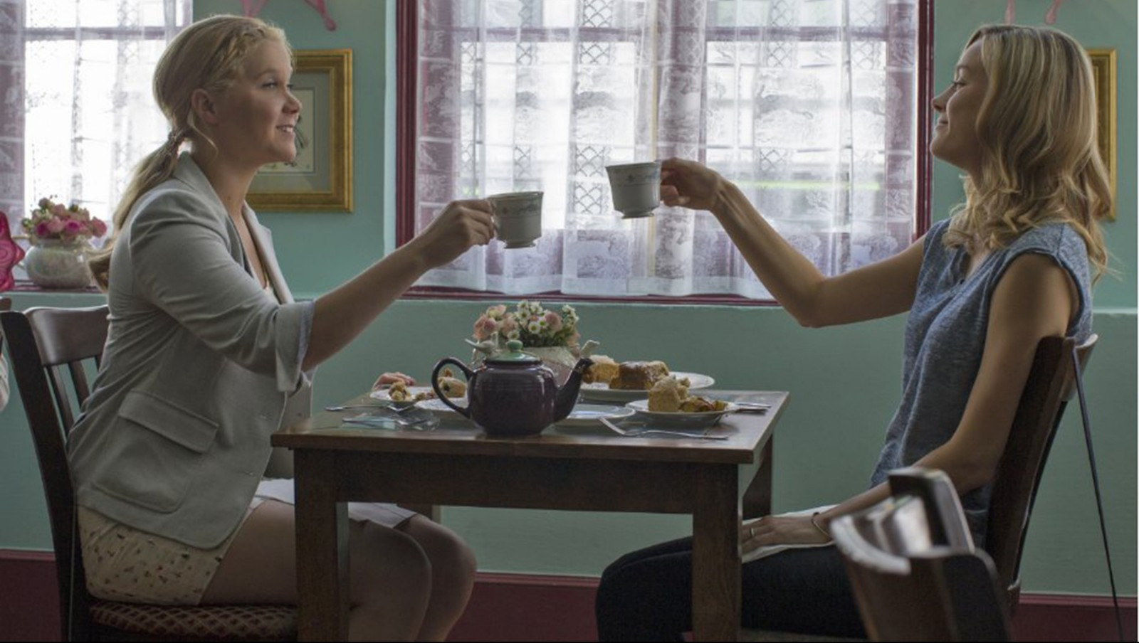 """Amy Schumer, left, and Brie Larson in """"Trainwreck."""""""
