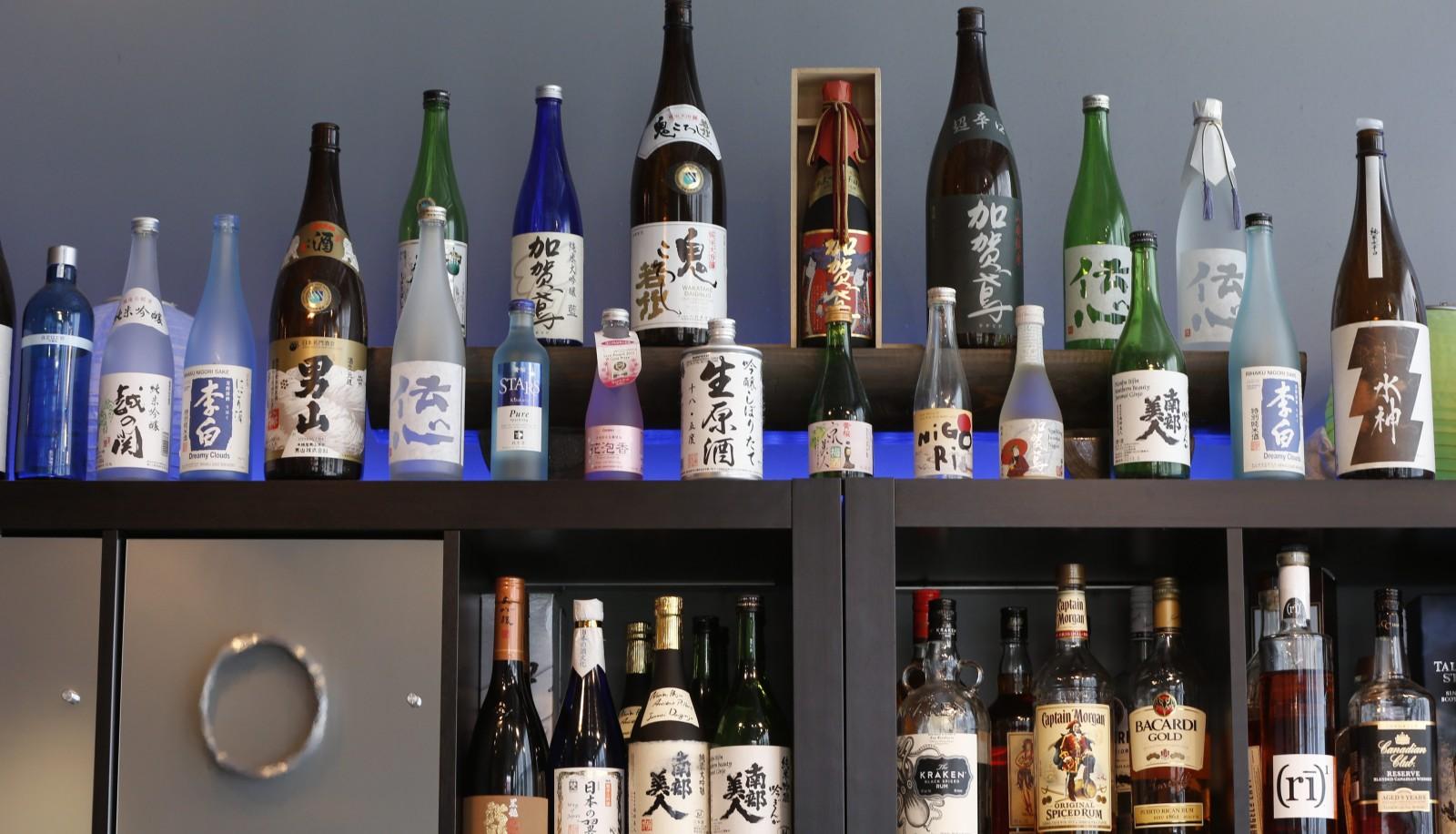 Sato's sake shelf in the restaurant on Elmwood Avenue. (Harry Scull Jr./Buffalo News)