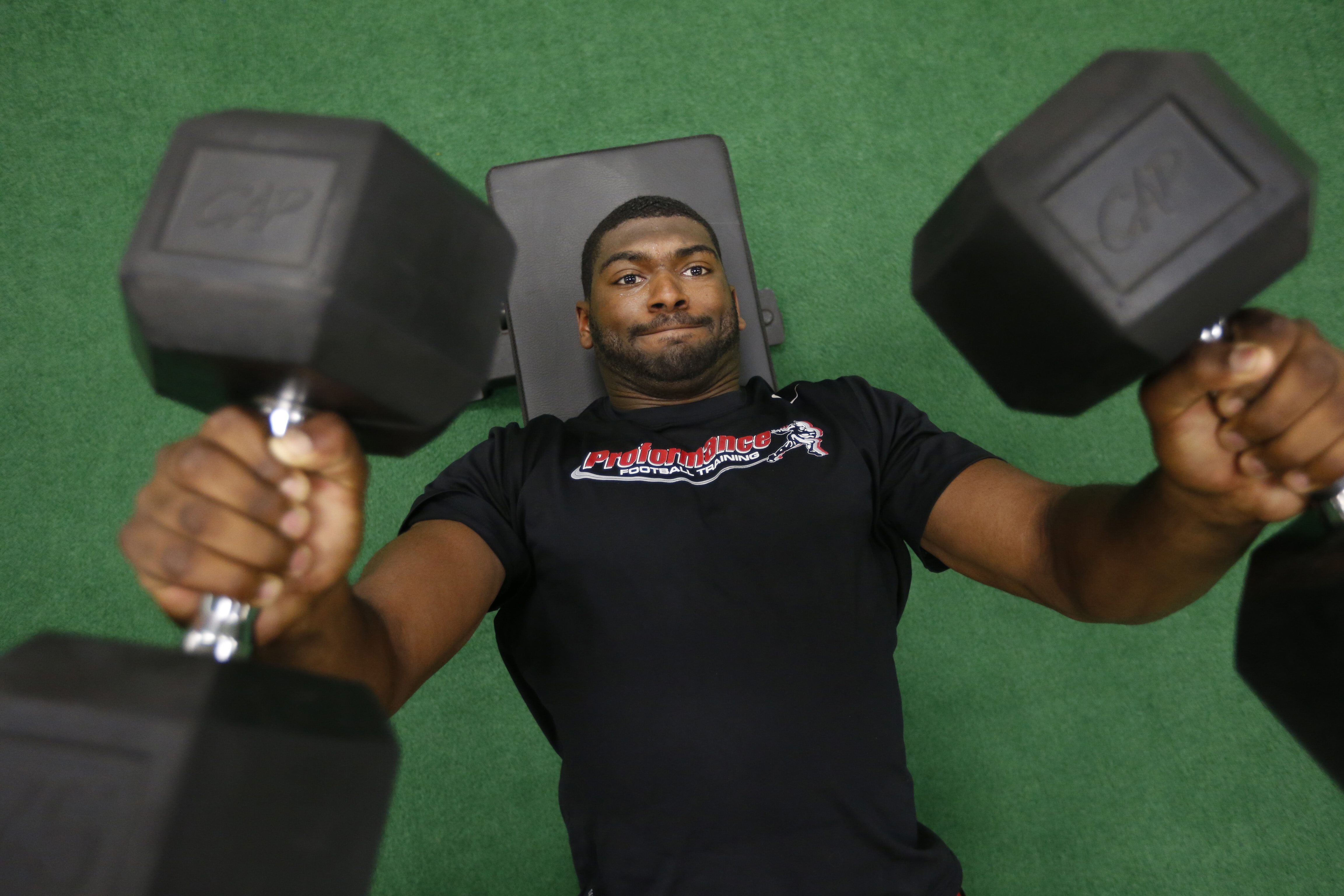 Getzville native Jimmy Gaines hits the free weights during a recent workout at Proformance at the Northtown Center in Amherst.