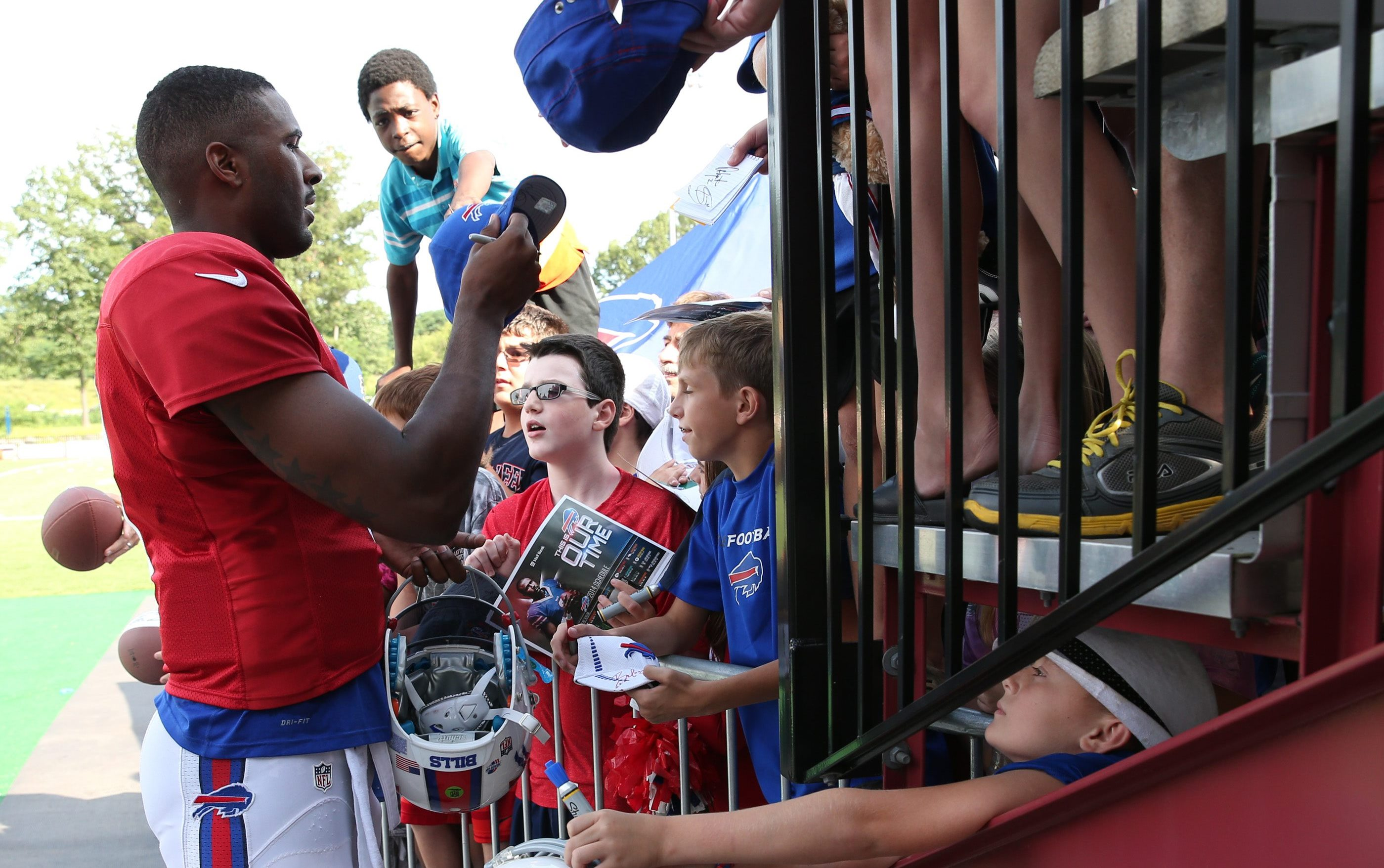 Fans look for every angle to get autographs at camp, as they did with EJ Manuel last year.