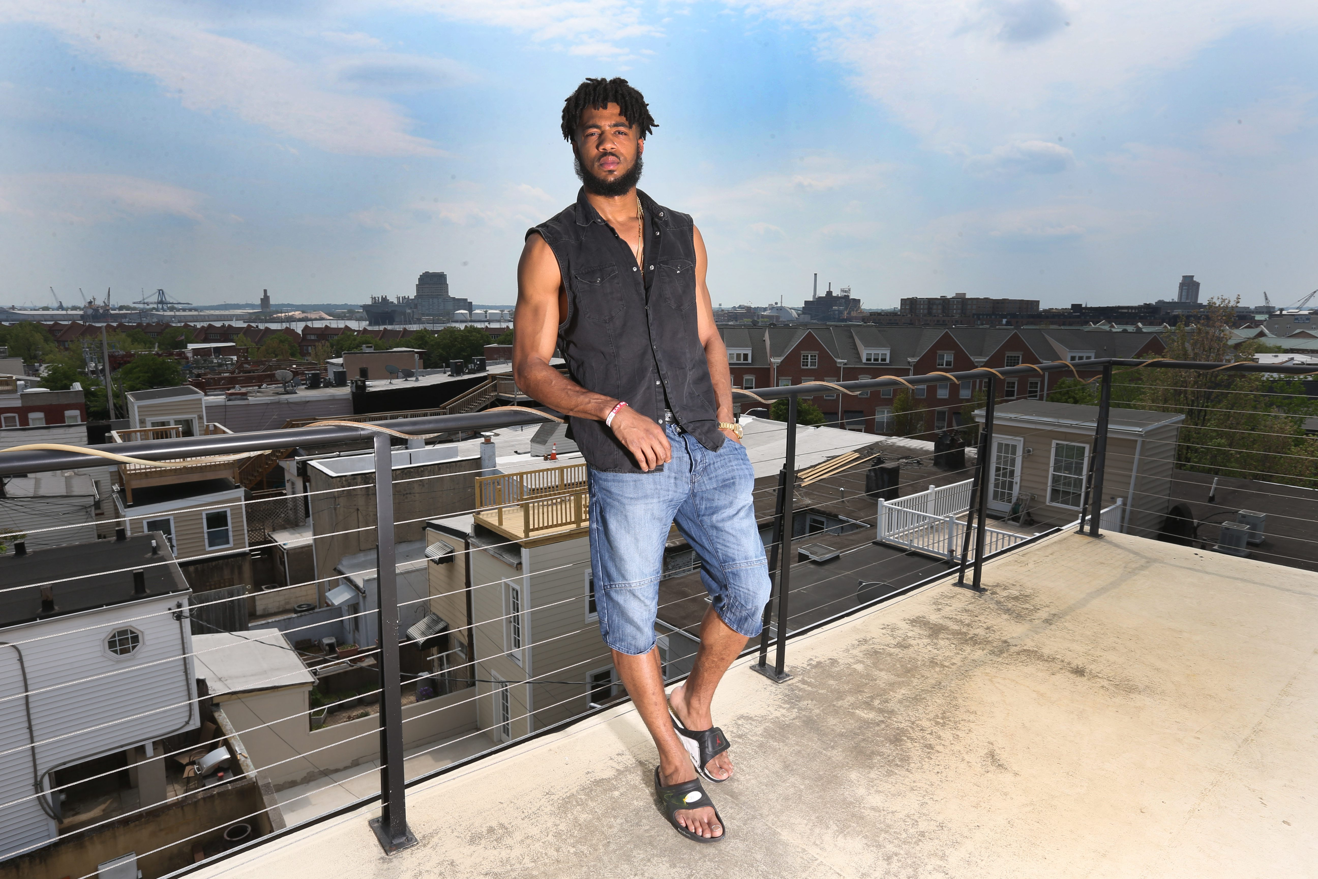 In this 2015 feature photo, former Buffalo Bills first-round draft pick Aaron Maybin stands on the balcony of his Baltimore home. (James P. McCoy/ Buffalo News)