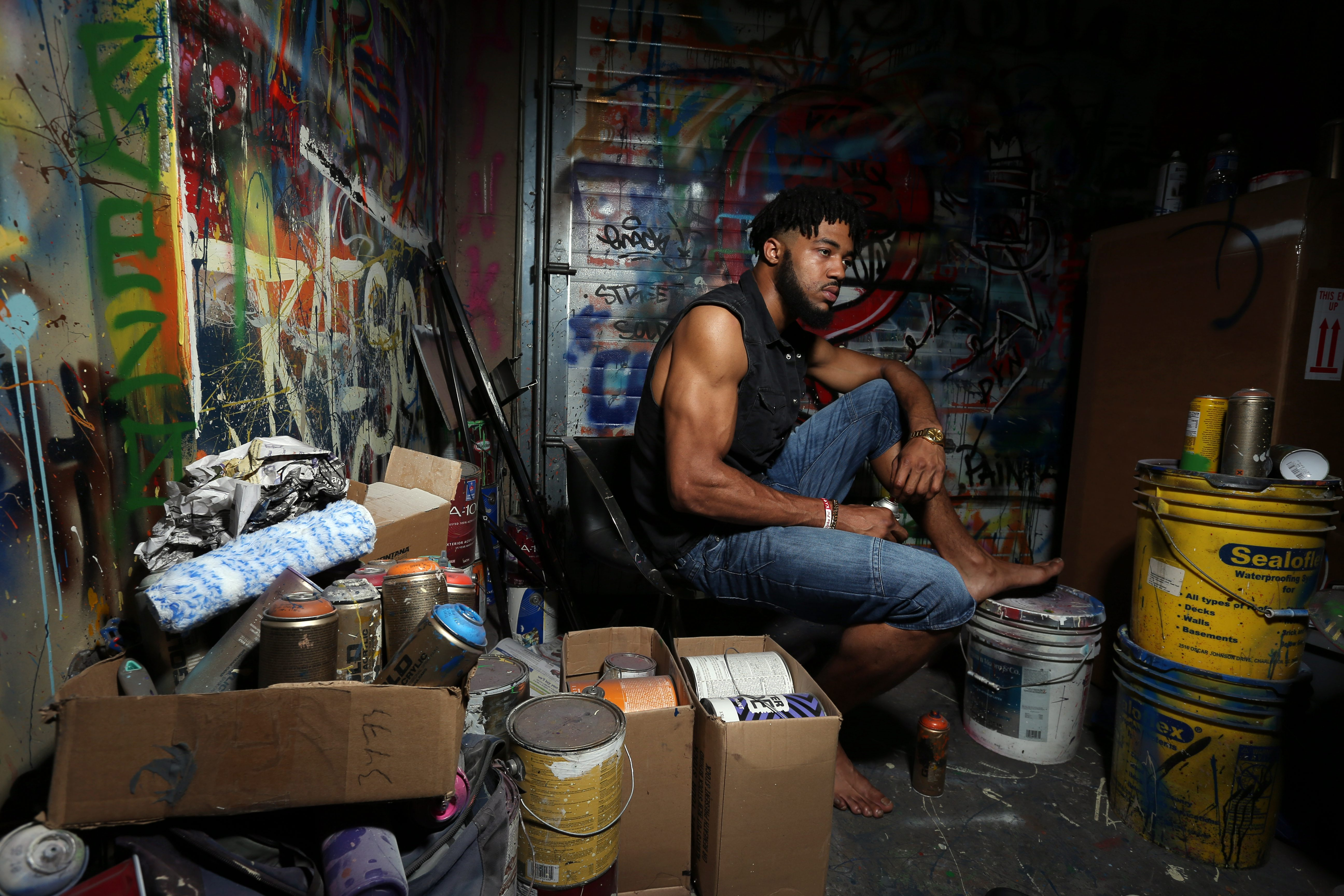 """Aaron Maybin, photographed in his Baltimore studio, is proud that he made enough money during four years in the NFL to retire his folks to South Carolina. """"My family wanted out, and through football, they got out."""" (James P. McCoy/Buffalo News)"""