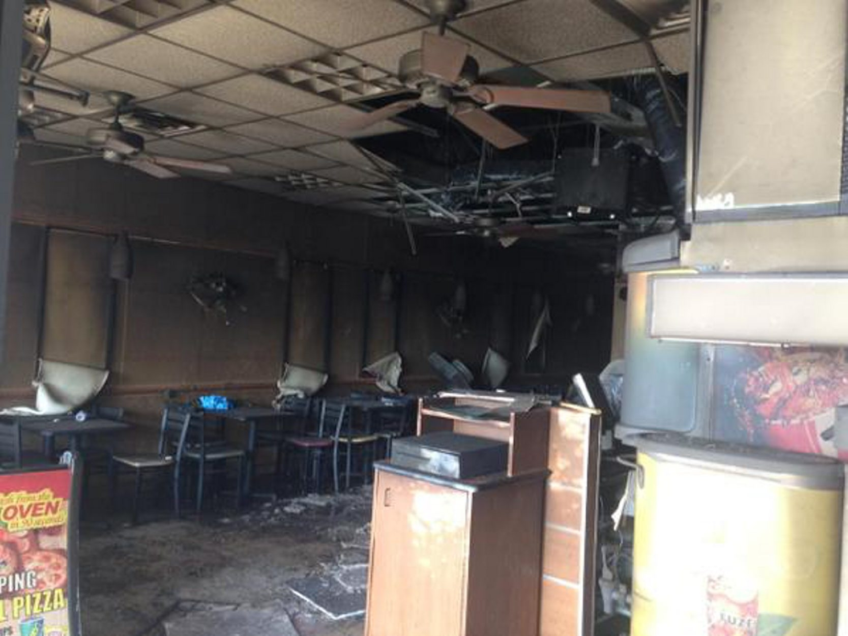 This is the scene inside the Subway shop at Maple Forest Plaza after an overnight fire. (John Hickey/Buffalo News)